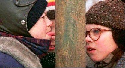 "Peter Billingsley, right, witnesses the result of a dare in the holiday classic ""A Christmas Story."""