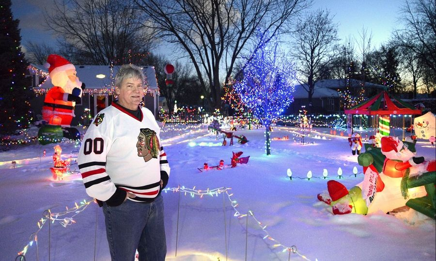 Garran Sparks has been decorating his home for 13 years. The display at his home, at 943 Bluestem Lane in Batavia, starts in the front yard and fills up the backyard (seen here) as well. Sparks won the Editor's Choice award for the Tri-Cities in the Daily Herald's holiday lights contest.