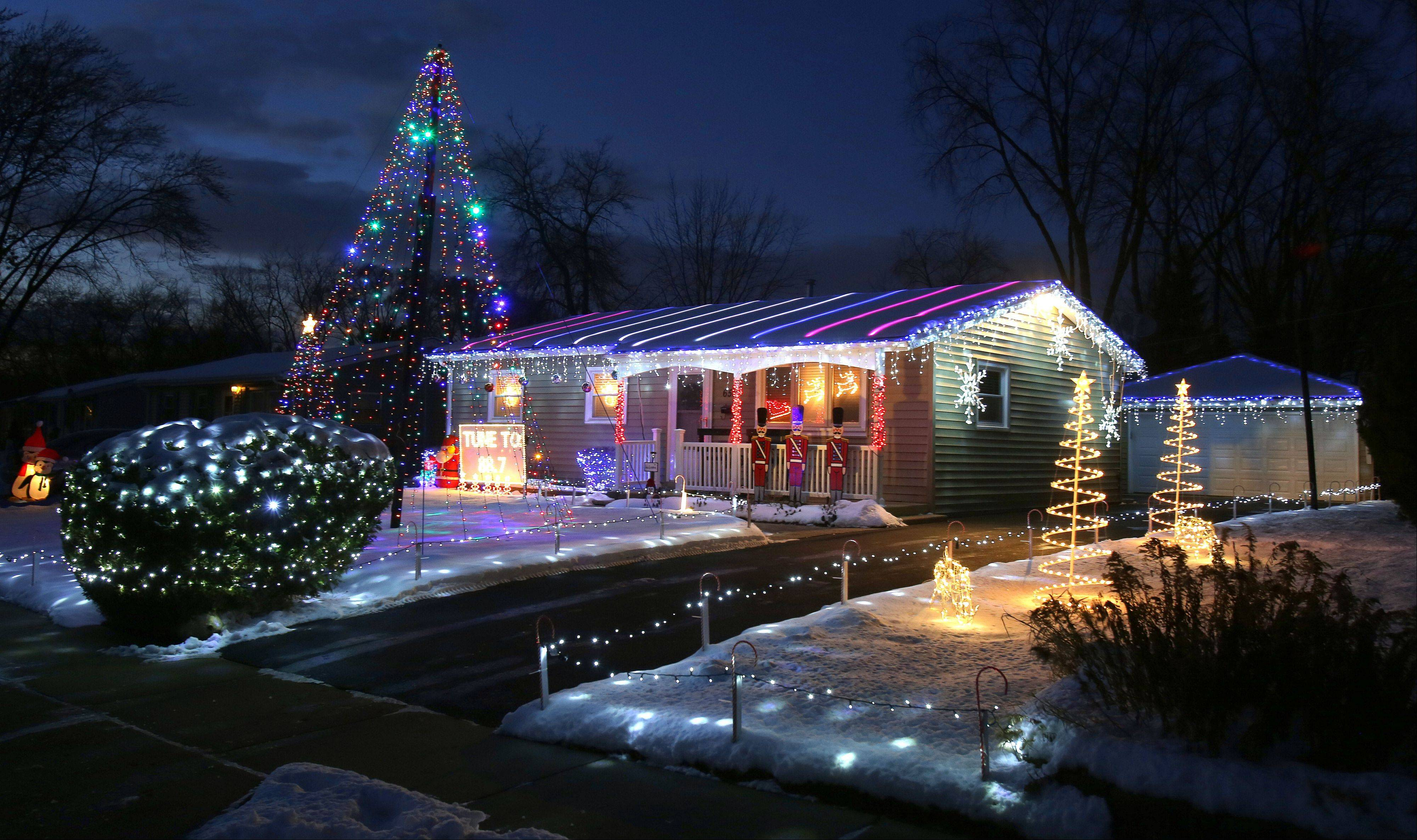 Mark Tarkowski of Wauconda has more than 9,000 lights in his Christmas display.