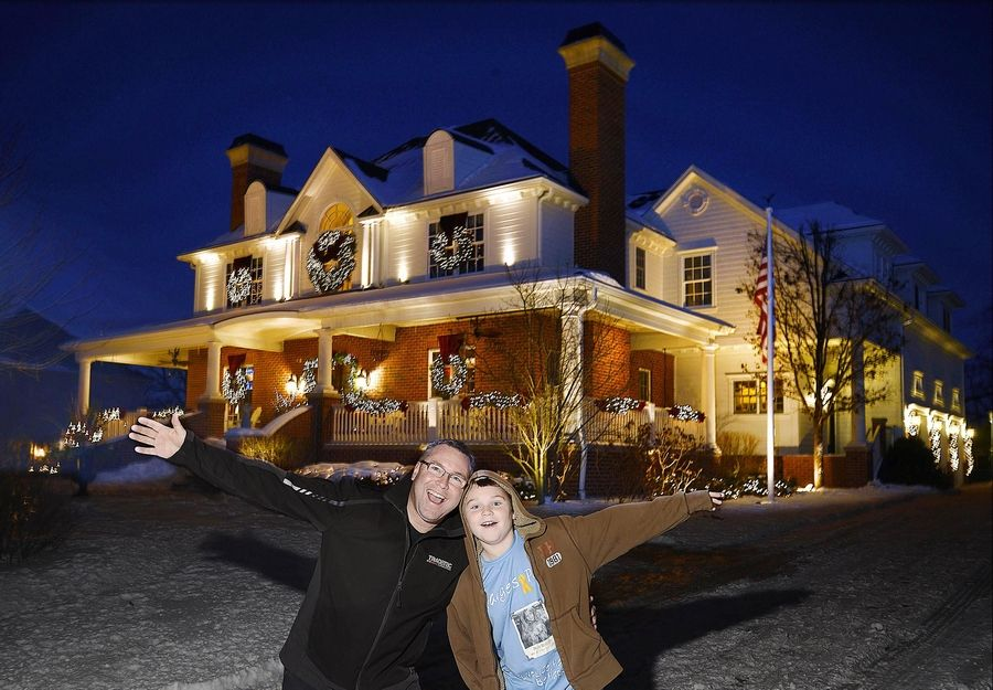 Ken Buckman and his son Sam with their holiday lights display at 197 Wrenwood Circle in Elgin. The Buckmans won the Editor's Choice award for the Fox Valley in the Daily Herald's holiday lights contest.