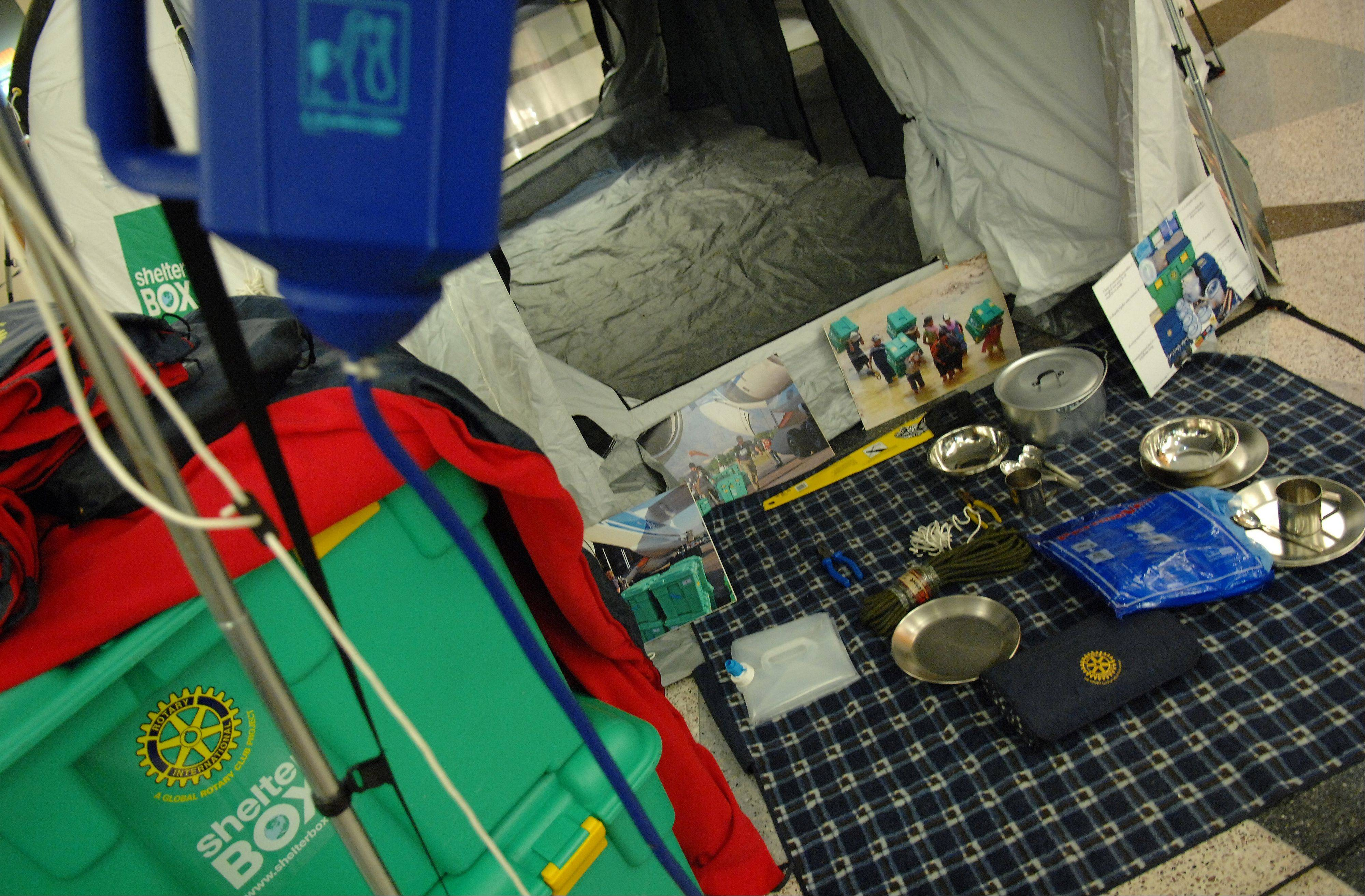 A single Shelter Box includes a 10-person tent and a range of survival goods including thermal blankets, a wood-burning stove and water purification equipment.