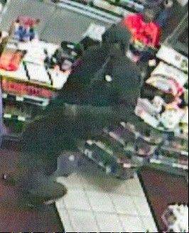 This is a surveillance camera photo of the suspect from a Nov. 5 Schaumburg armed robbery. The man is believed to have been involved in more than a dozen other robberies.