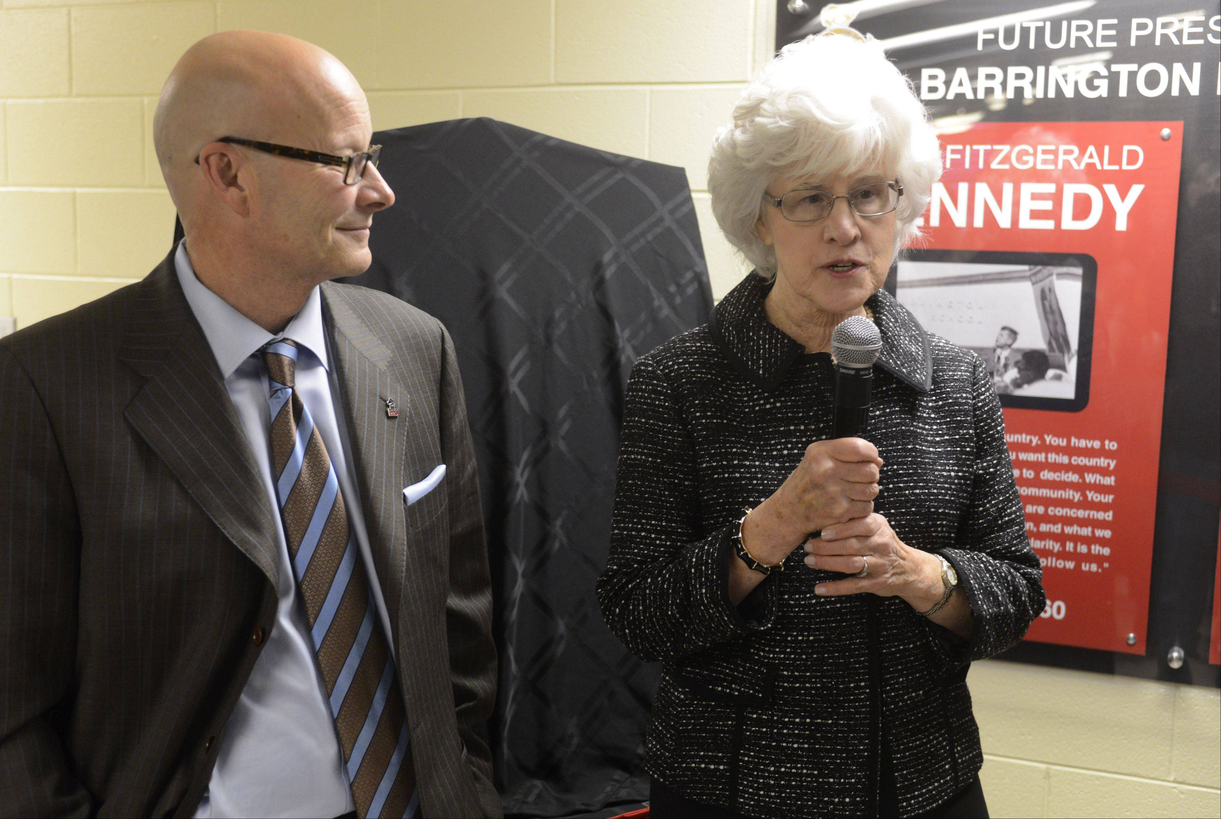 Tom Leonard, Barrington Unit District 220 superintendent, stands with donor Joyce Taillon just before newly discovered photos of John F. Kennedy's October 1960 visit to Barrington High School are unveiled Tuesday at the school.
