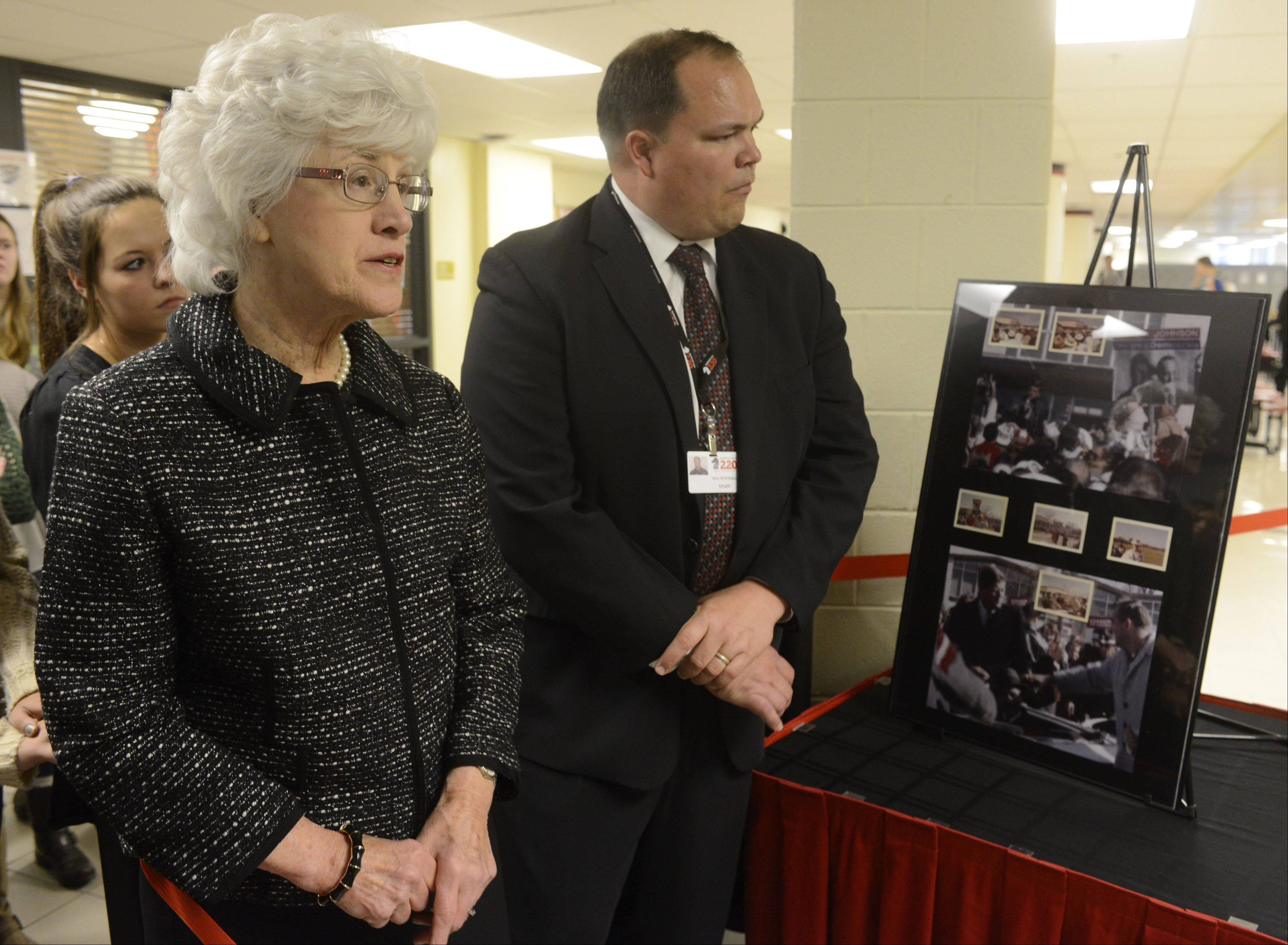 Donor Joyce Taillon talks about her newly discovered photos of John F. Kennedy's October 1960 visit to Barrington High School are unveiled Tuesday at the school. Standing with her is school Principal Steve McWilliams.