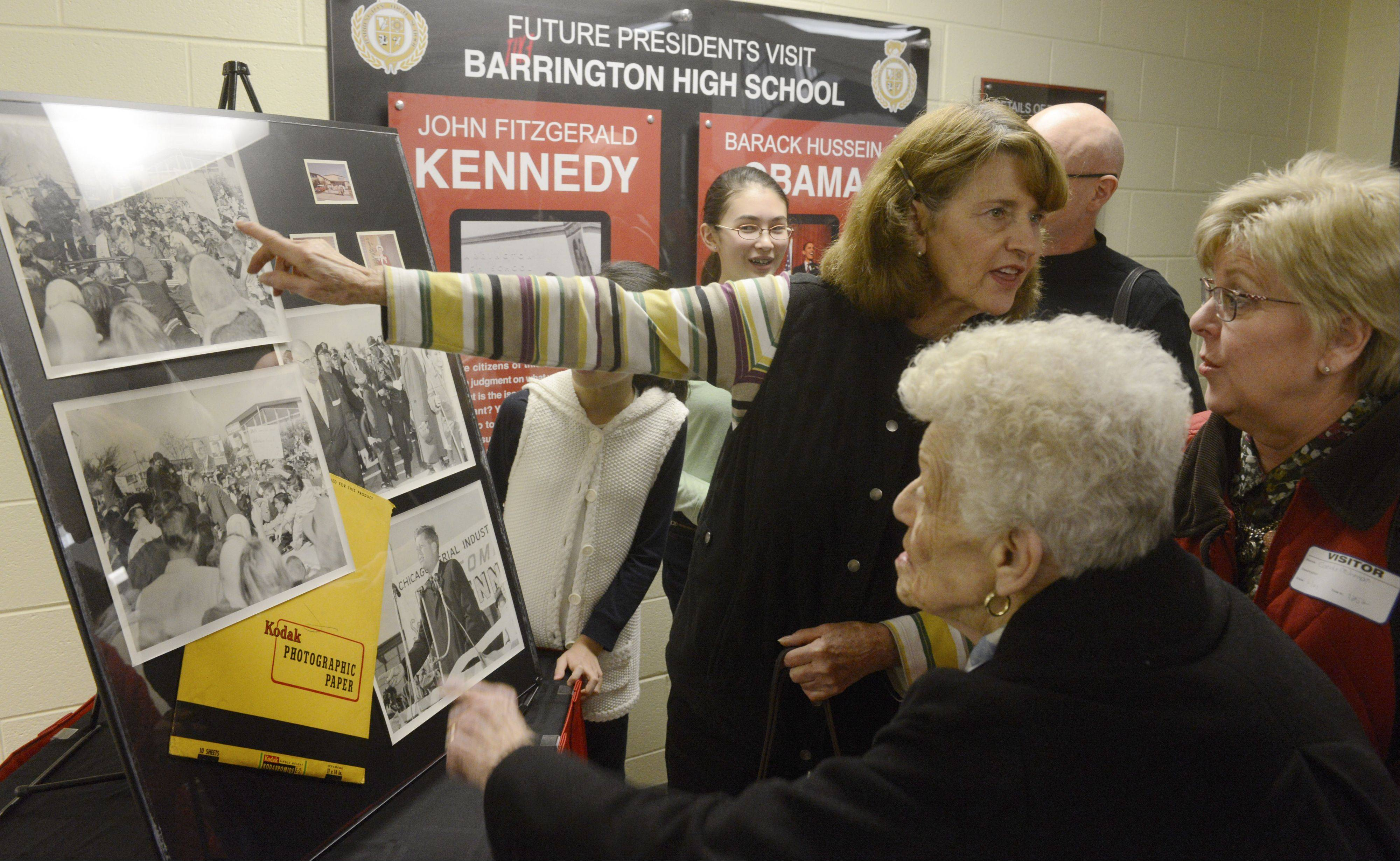 Joanne Barrett, front, and her daughter, Candi Ashman, right, talk with Kay Quam about newly discovered photos of John F. Kennedy's October 1960 visit to Barrington High School, unveiled Tuesday at the school. Barrett's father is shown in one of the photos.