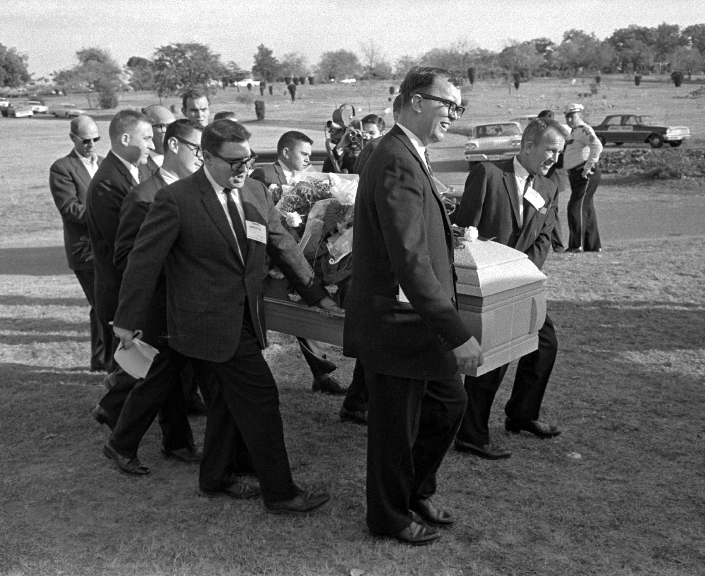 Reporters were enlisted to act as pallbearers at the interment of Lee Harvey Oswald at the Shannon Rose Hill Cemetery in 1963.