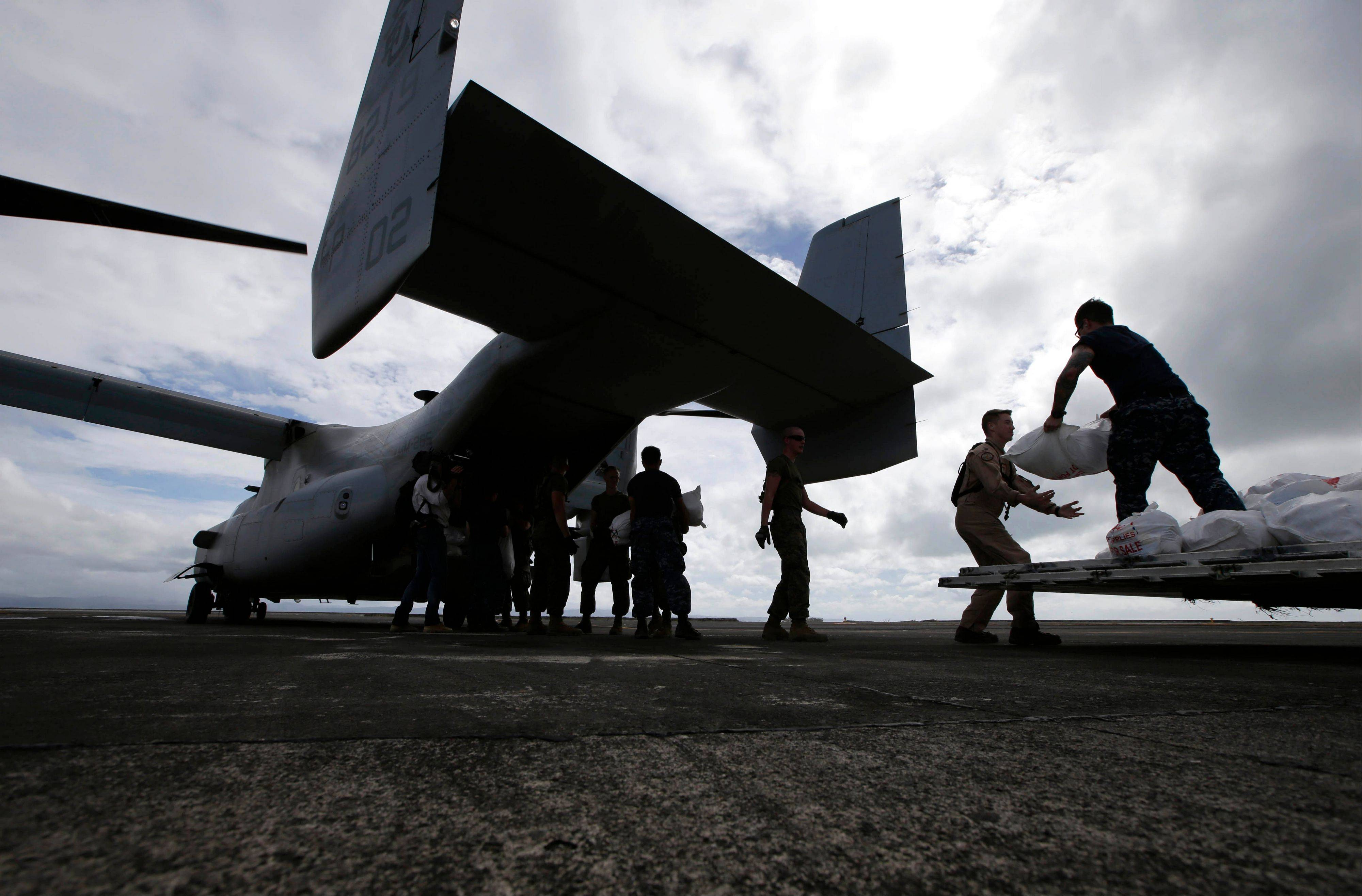 U.S. troops load relief supplies to a U.S. Marine MV-22 Osprey aircraft for airdrop to typhoon-ravaged remote places in central Philippines. The Marines' newest and in some quarters most controversial transport airplane is showing the world what it's got -- for the sake of the victims of Typhoon Haiyan, and perhaps its own future.