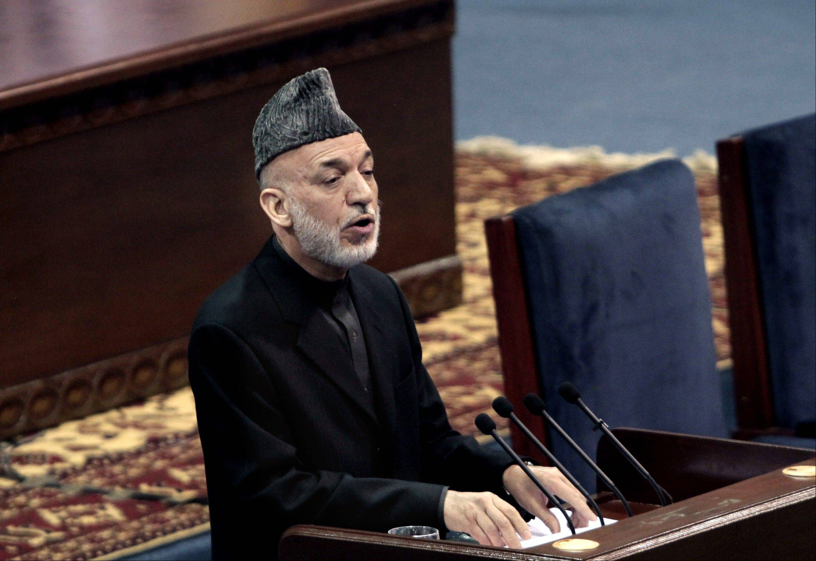 Afghan President Hamid Karzai urged tribal elders Thursday to support a security deal with the United States, but in a surprising about-face said he would defer the signing of the agreement to the winner of next year's presidential elections, which he is barred from contesting.