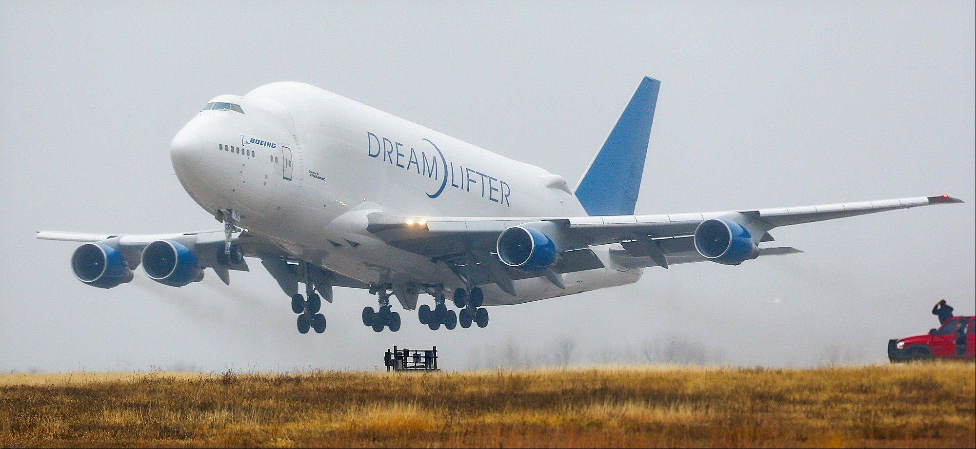 "A Boeing 747 ""Dreamlifter"" takes off Thursday, the day after it mistakenly landed at Col. James Jabara Airport in Wichita, Kan. The jet was supposed to land about 8 miles away, at the McConnell Air Force Base."