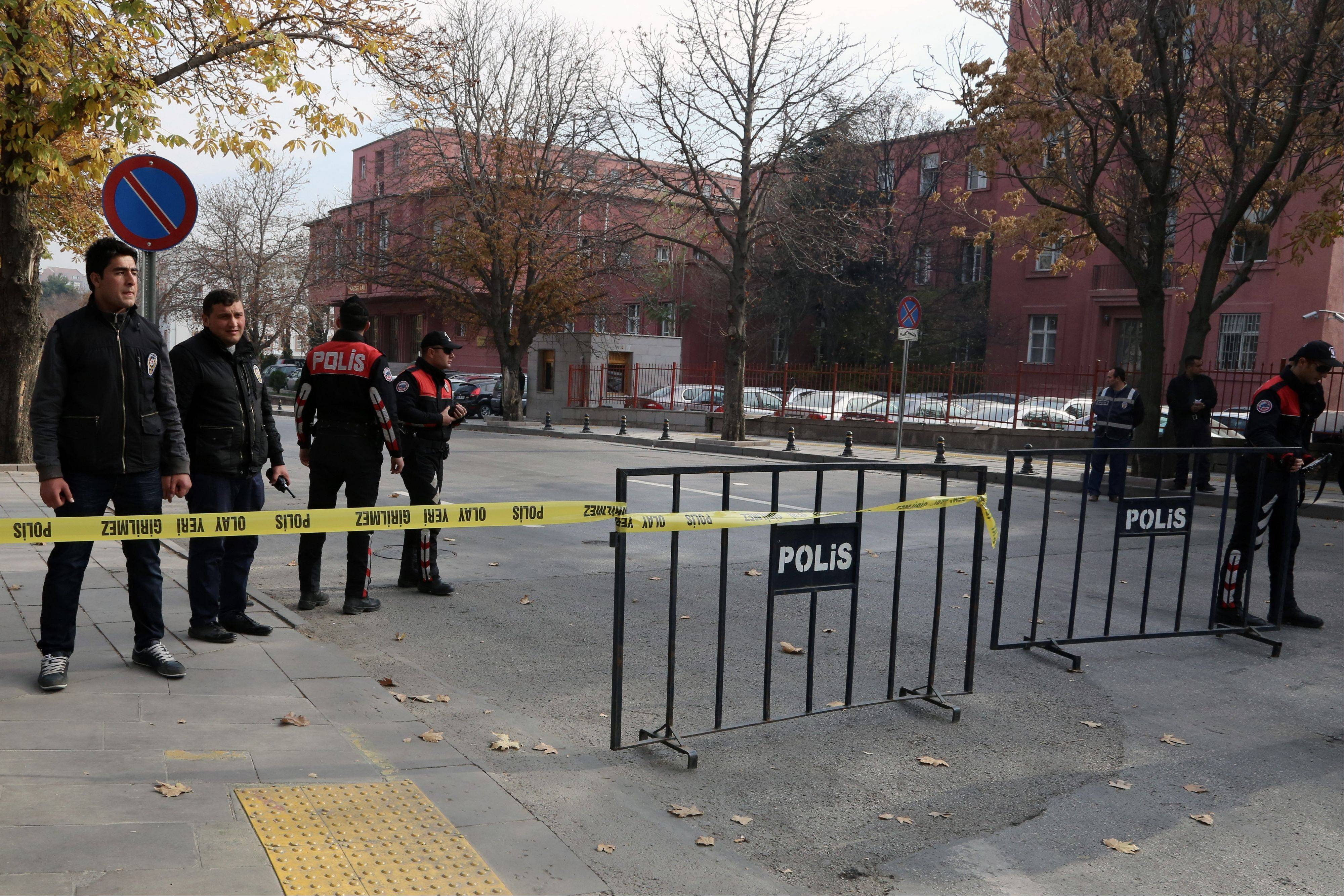 Security officials close a road leading to Turkish Prime Minister Recep Tayyip Erdogan's office Thursday shortly after police subdued a man who was carrying a fake bomb in Ankara, Turkey. Police fired two warning shots in the air before overpowering and arresting him, said an aide to the prime minister. The 53-year-old man, identified as Tugrul B., was carrying a device made to look like a bomb, the official said. He was being questioned and the motive for his action was not immediately known.