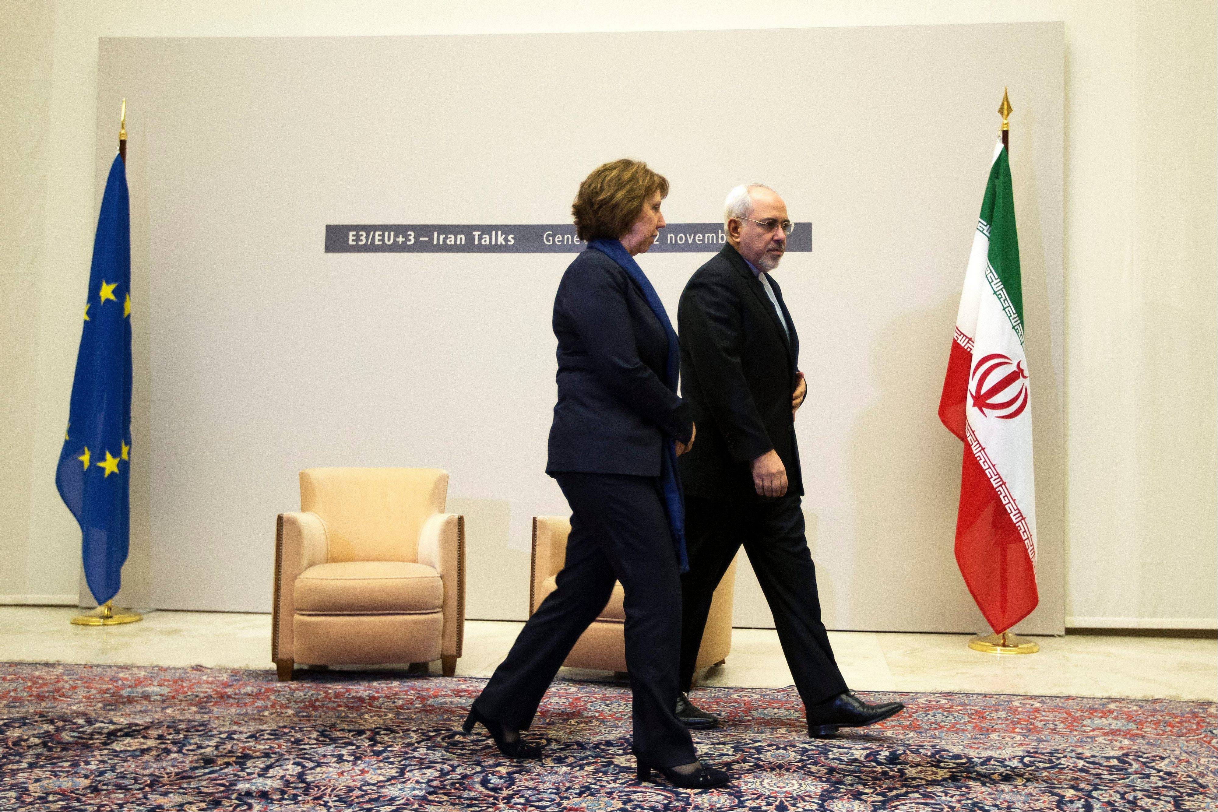 EU High Representative for Foreign Affairs Catherine Ashton, left, and Iranian Foreign Minister Mohammad Javad Zarif leave a photo opportunity Wednesday prior to the start of three days of closed-door nuclear talks in Geneva, Switzerland.