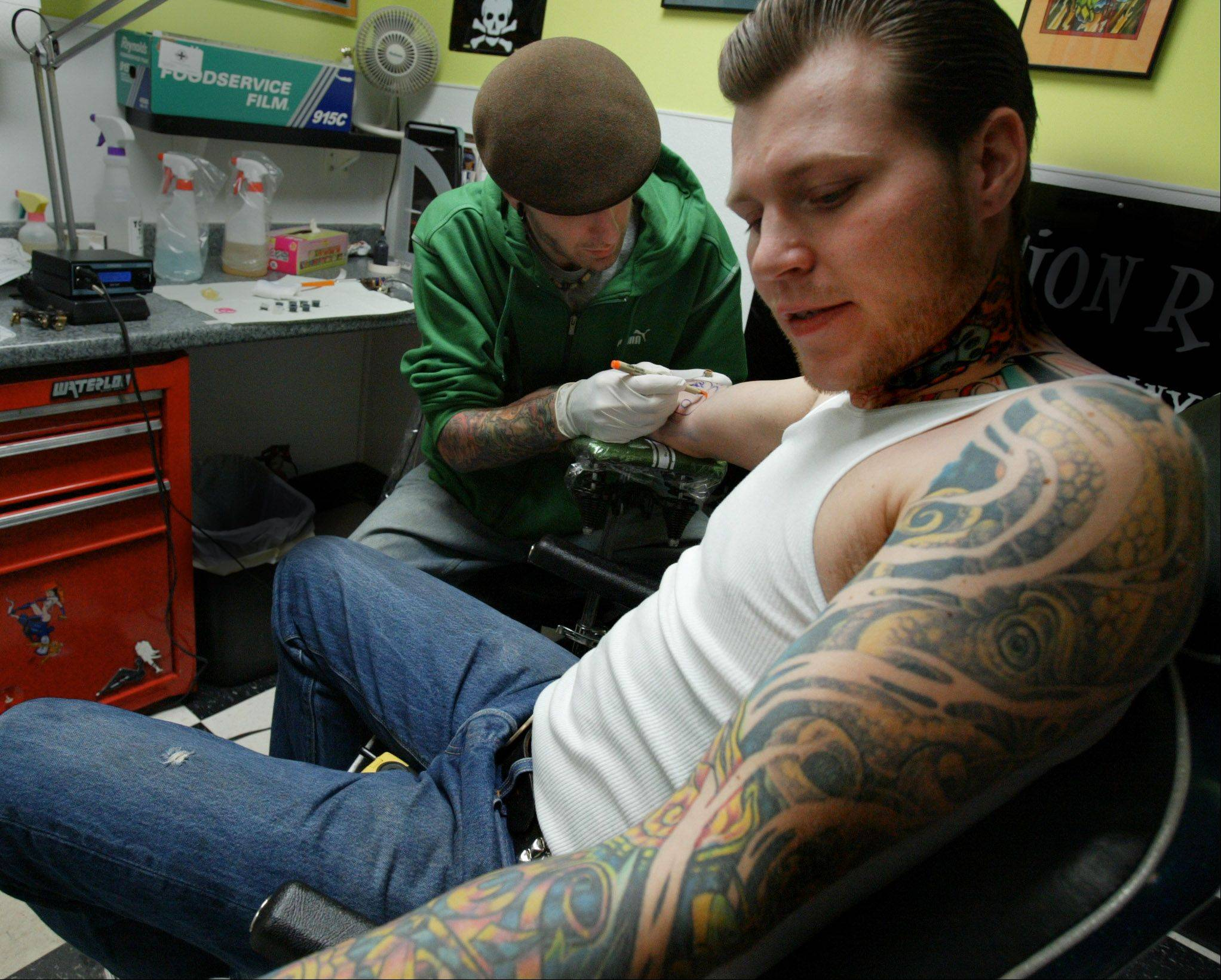 James Steinke, owner of Topnotch Tattoos in Elgin, now has more competition after the Elgin City Council approved a third tattoo parlor for downtown.