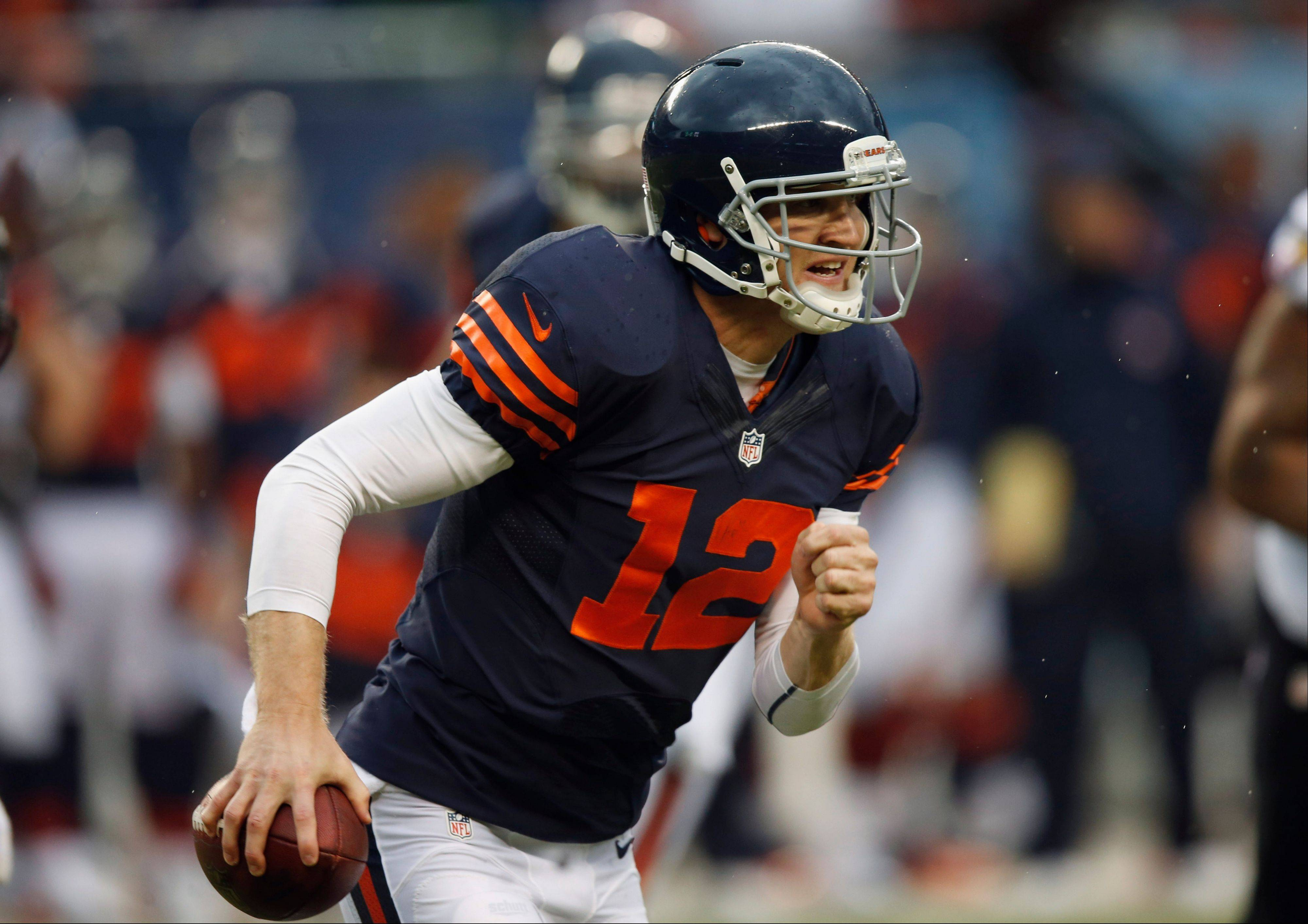 Josh McCown (12) scrambles during the first half of an NFL football game against the Baltimore Ravens, Sunday, Nov. 17, 2013, in Chicago.