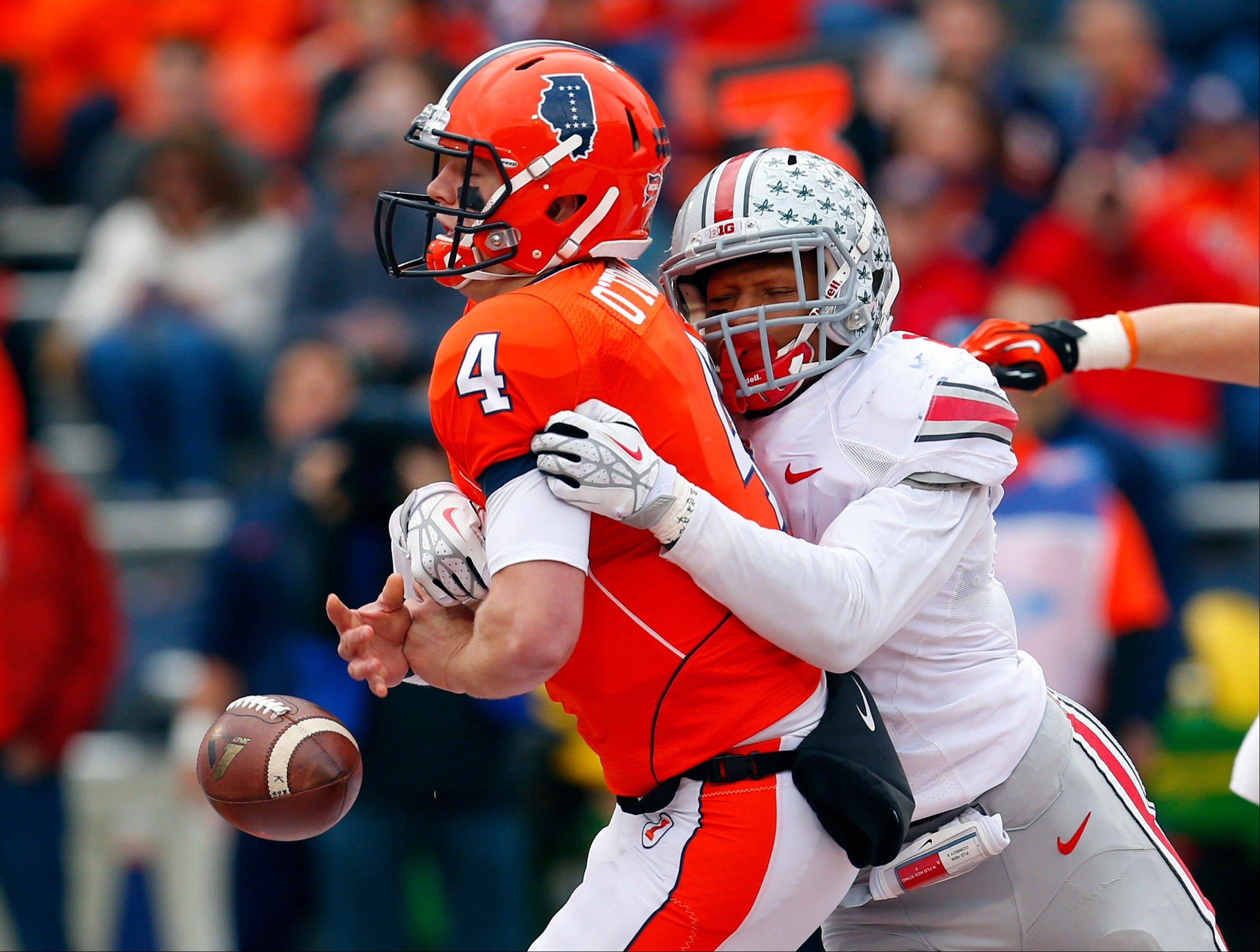 Ohio State safety Christian Bryant strips the ball from Illinois quarterback Reilly O'Toole during the second half of last Saturday's 60-35 win in Champaign, Ill.