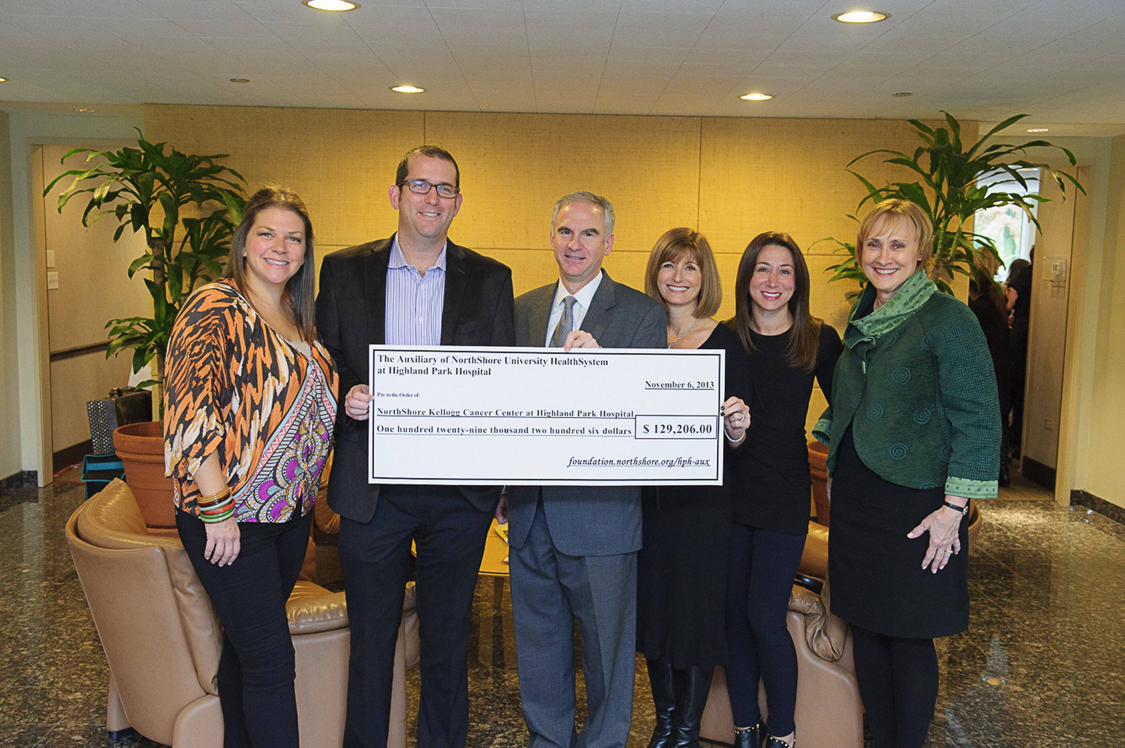 The Auxiliary of NorthShore University HealthSystem at Highland Park Hospital proudly presents a check for $129,206 to Kellogg Cancer Center at NorthShore Highland Park Hospital