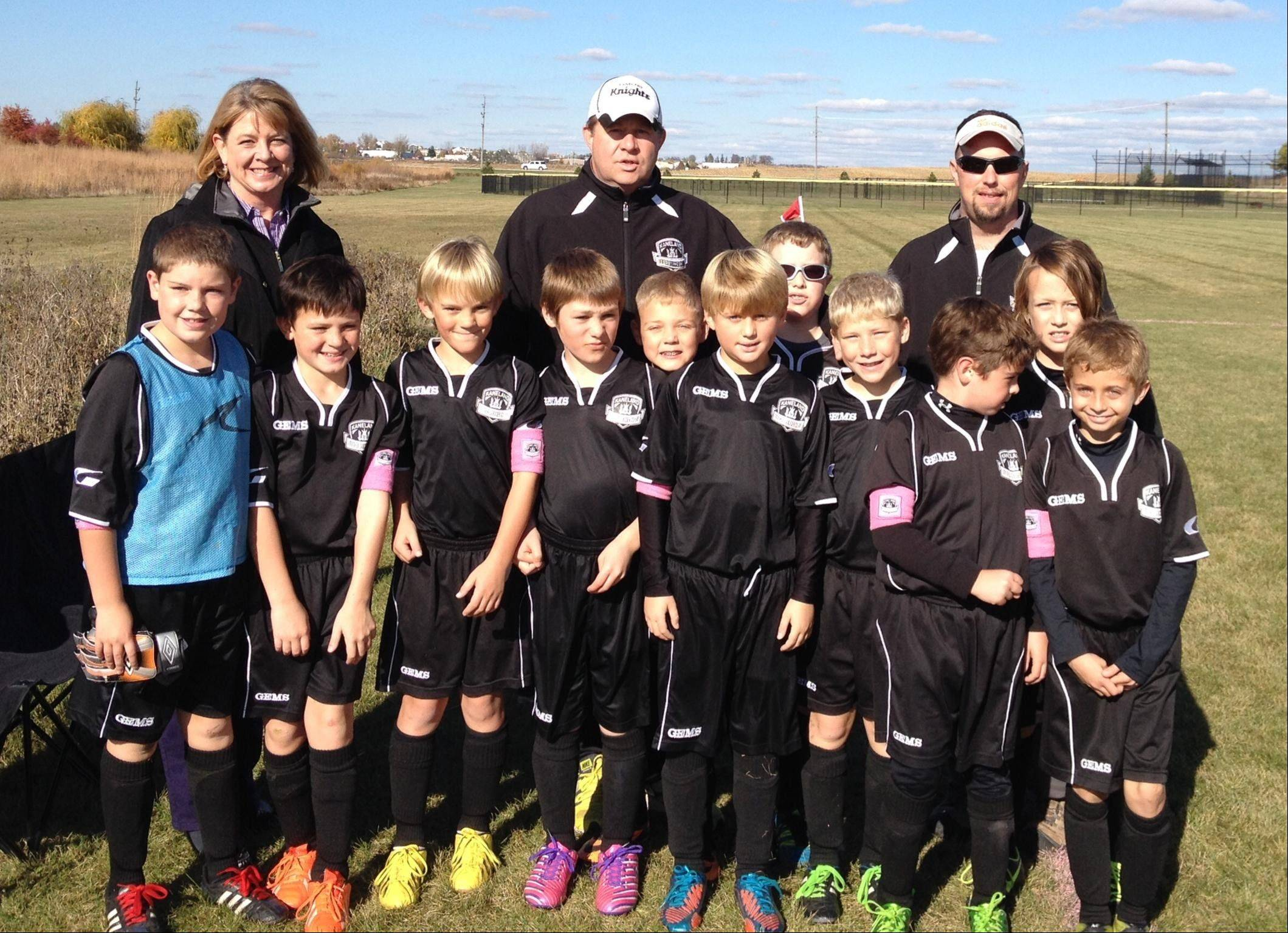 Kaneland High principal Jill Maras, left, on behalf of recipient Bridget Sweeney, thanks the Kaneland United Soccer Club for the Think Pink fundraiser. Pictured are: from left, front row, Lucas Pehl, Jake Guernon, Cade Ory, Sean Gannon, Nick Cummings, Nick Mitchinson, Joshua Pehl, Nicky Montalbano, Will Sand, Ryan Nudo; and back row, coach Mike Mitchinson, Jack Rissman and assistant coach Joel Rissman.