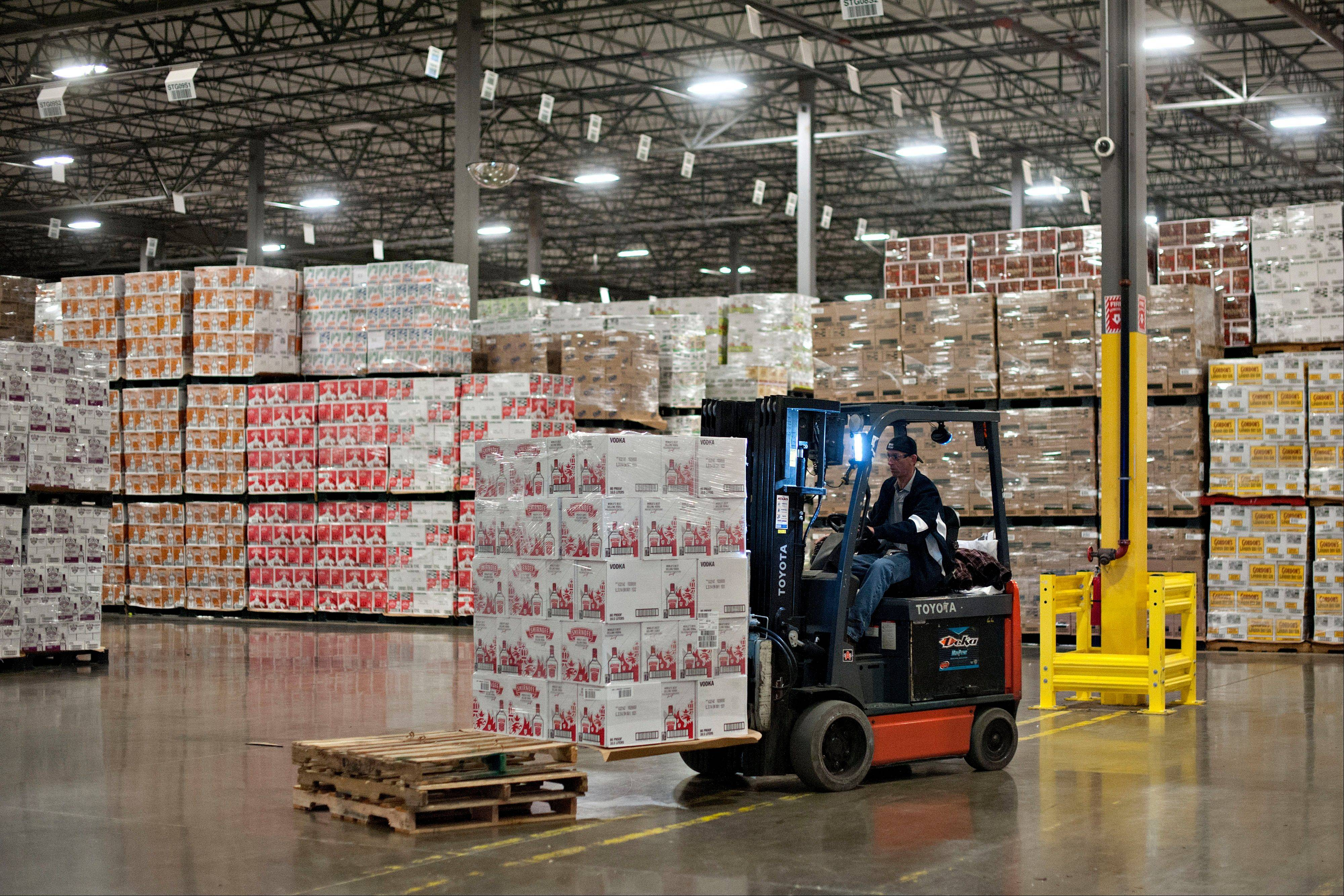 A forklift operator moves a stack of Diageo Plc�s Smirnoff brand vodka in a distribution warehouse in Bolingbrook.