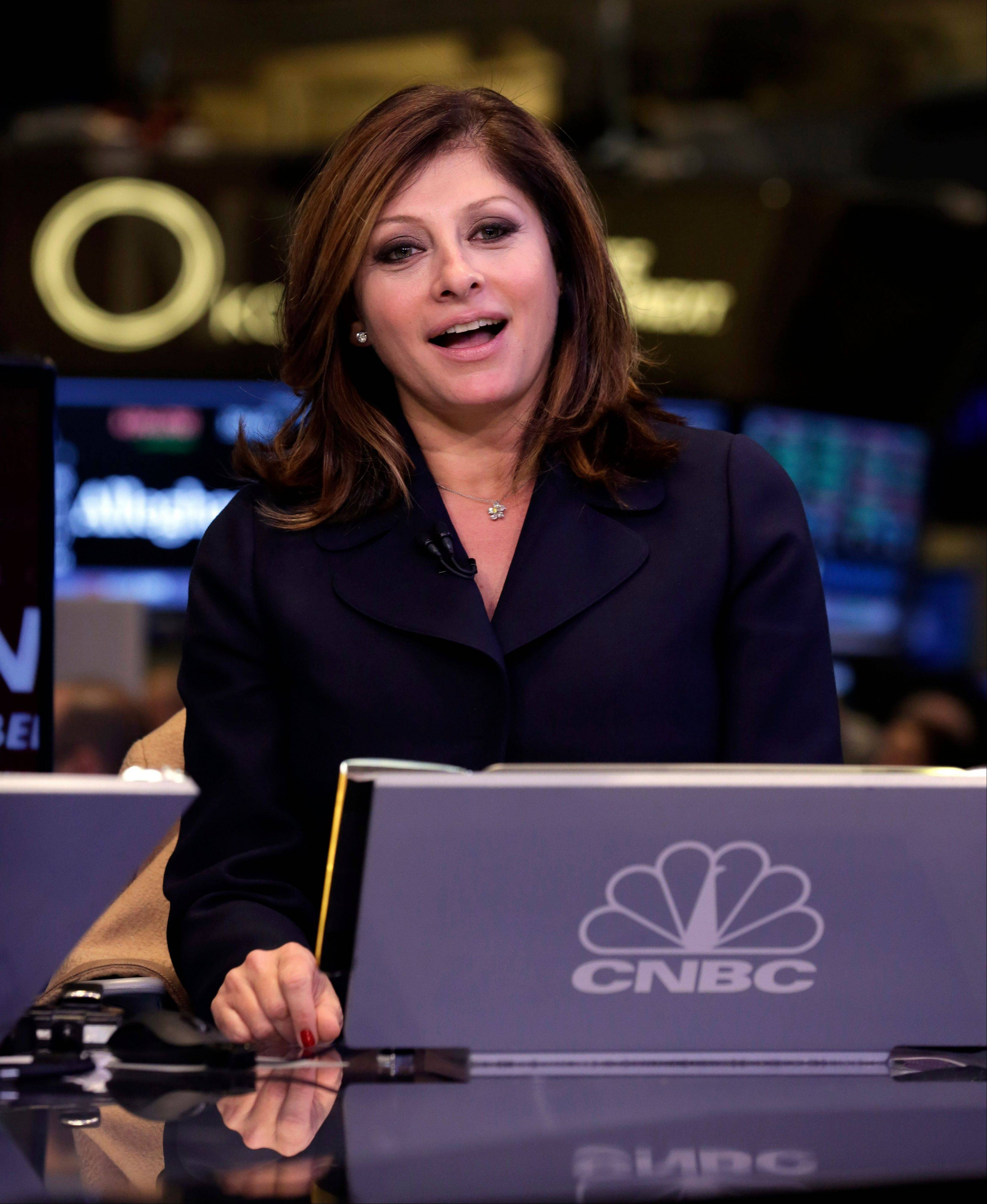 CNBC reporter Maria Bartiromo broadcasts Friday on her last day for the channel, on the floor of the New York Stock Exchange. Bartiromo is leaving the business news channel when her contract ends Nov. 24, concluding 20 years with CNBC.