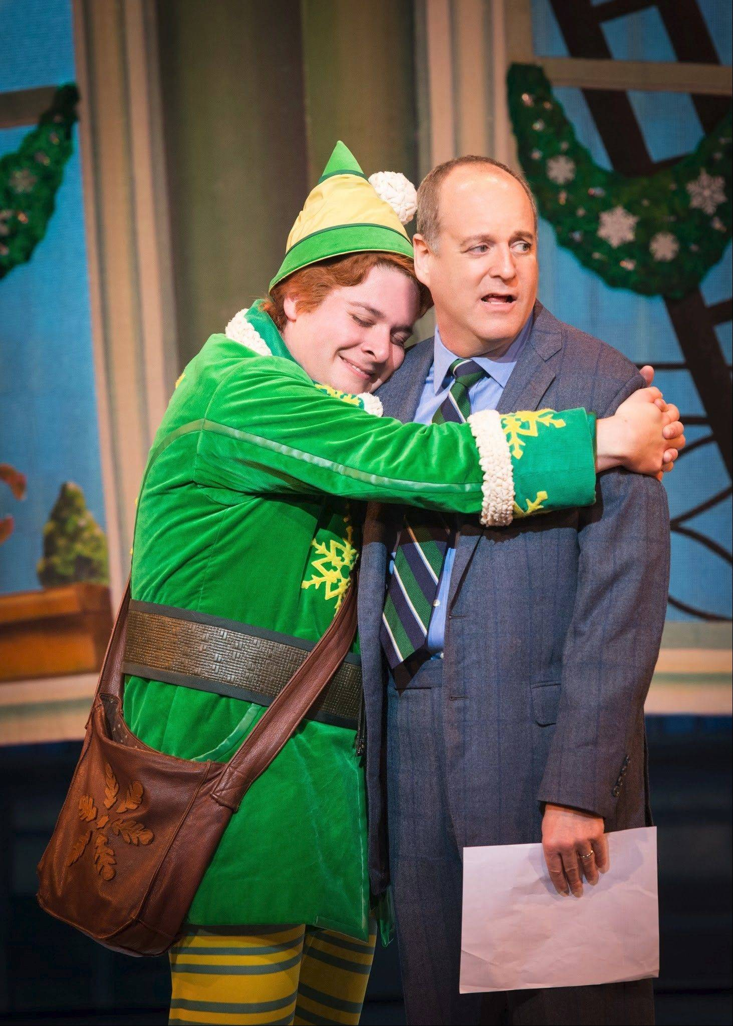 "Buddy (Will Blum) hugs his reluctant father, Walter (Larry Cahn), in ""Elf The Musical,"" making its Chicago debut at the Cadillac Palace Theatre from Tuesday, Dec. 26, through Sunday, Dec. 15."