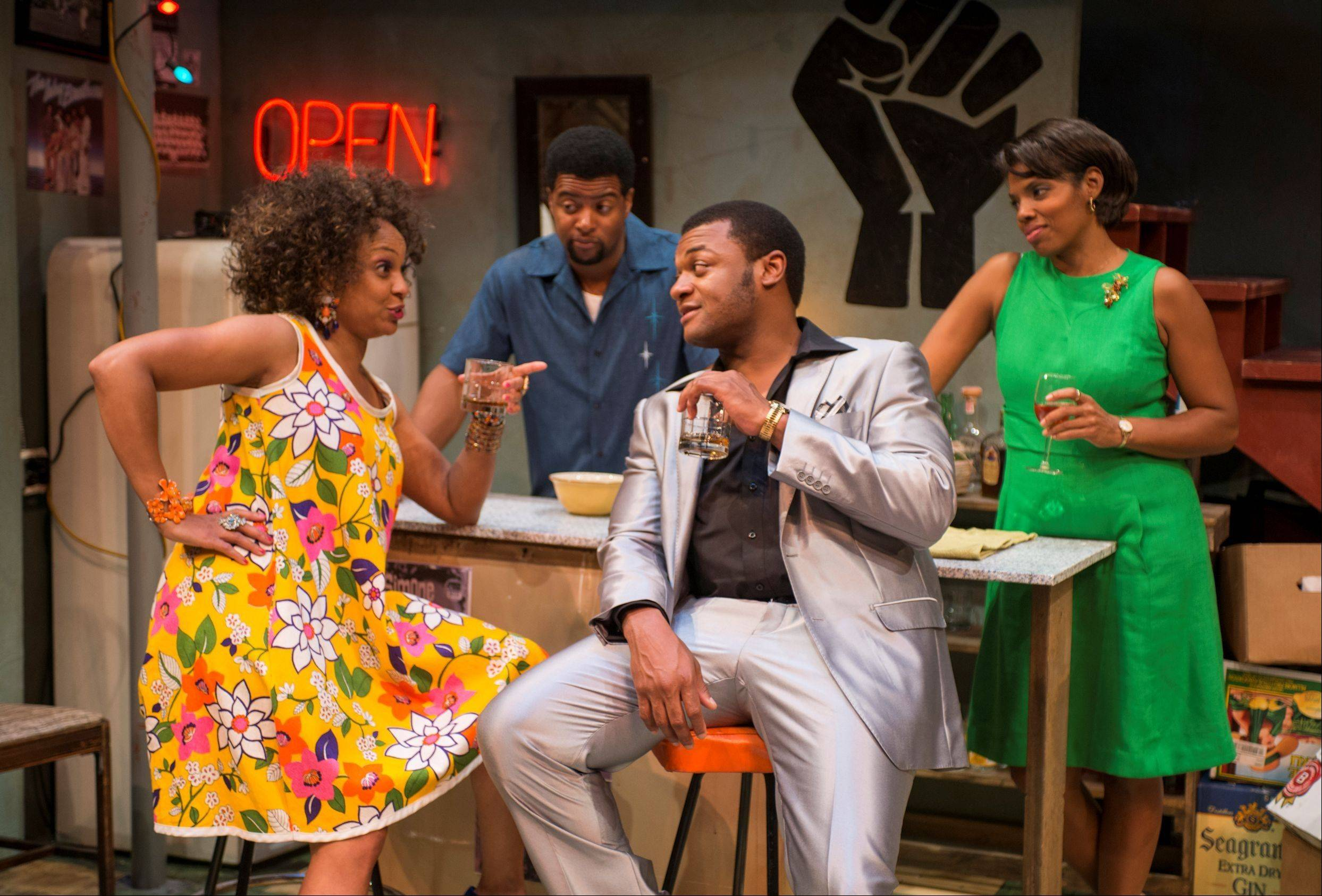 "In Detroit in the summer of 1967, Lank (Kamal Angelo Bolden, second from left) and Chelle (Tyla Abercrumbie, right) prepare to open their after-hours, basement club with help from friends Bunny (Coco Elysses, left) and Sly (Kelvin Roston Jr., second from right) in Northlight Theatre's Midwest premiere of ""Detroit '67"" by Dominique Morisseau."
