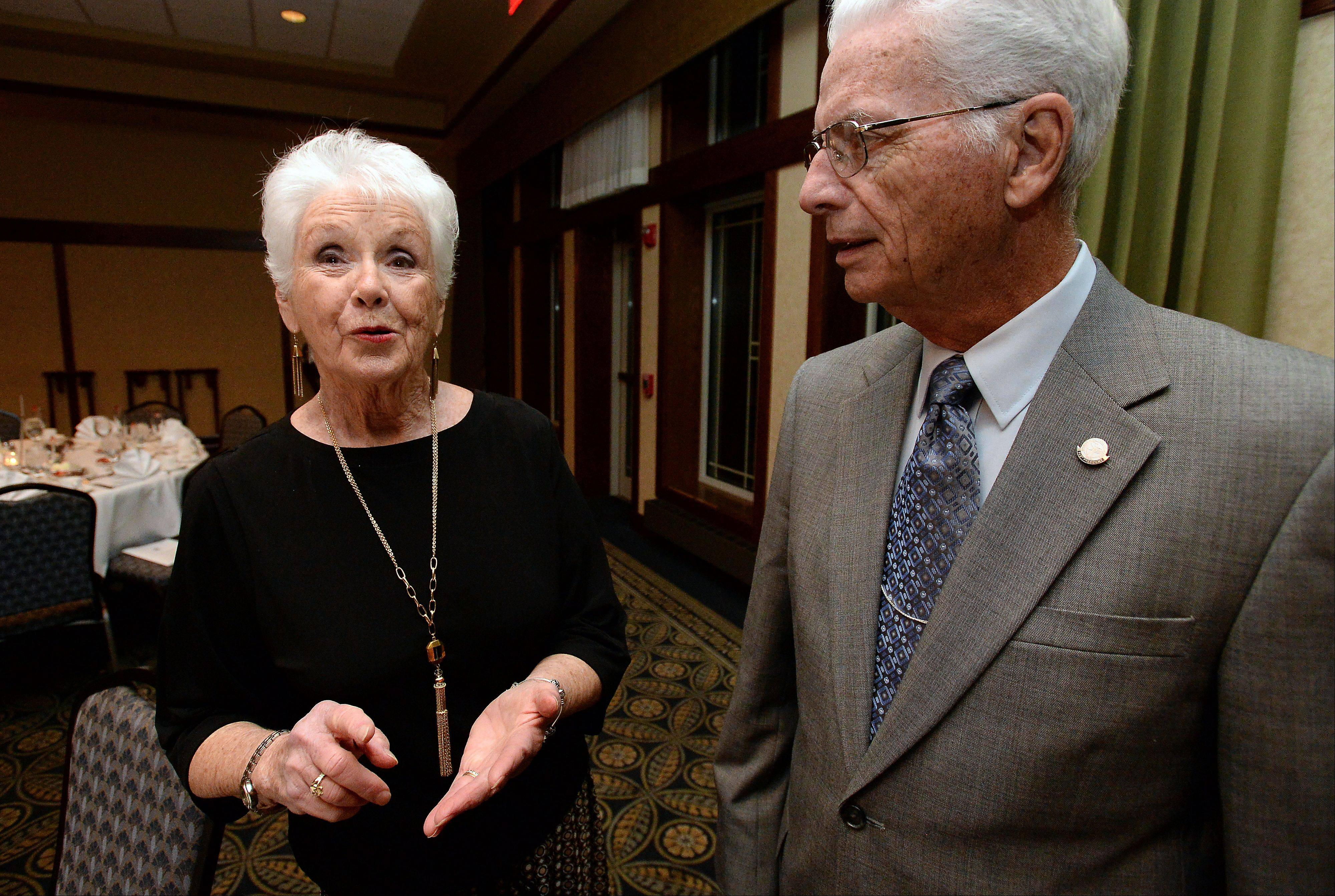Jane Sherlock of Buffalo Grove talks with her husband, Dan, about the activities which led to her being honored with the Senior Volunteer Award at the Heart of Buffalo Grove Awards Gala on Saturday.