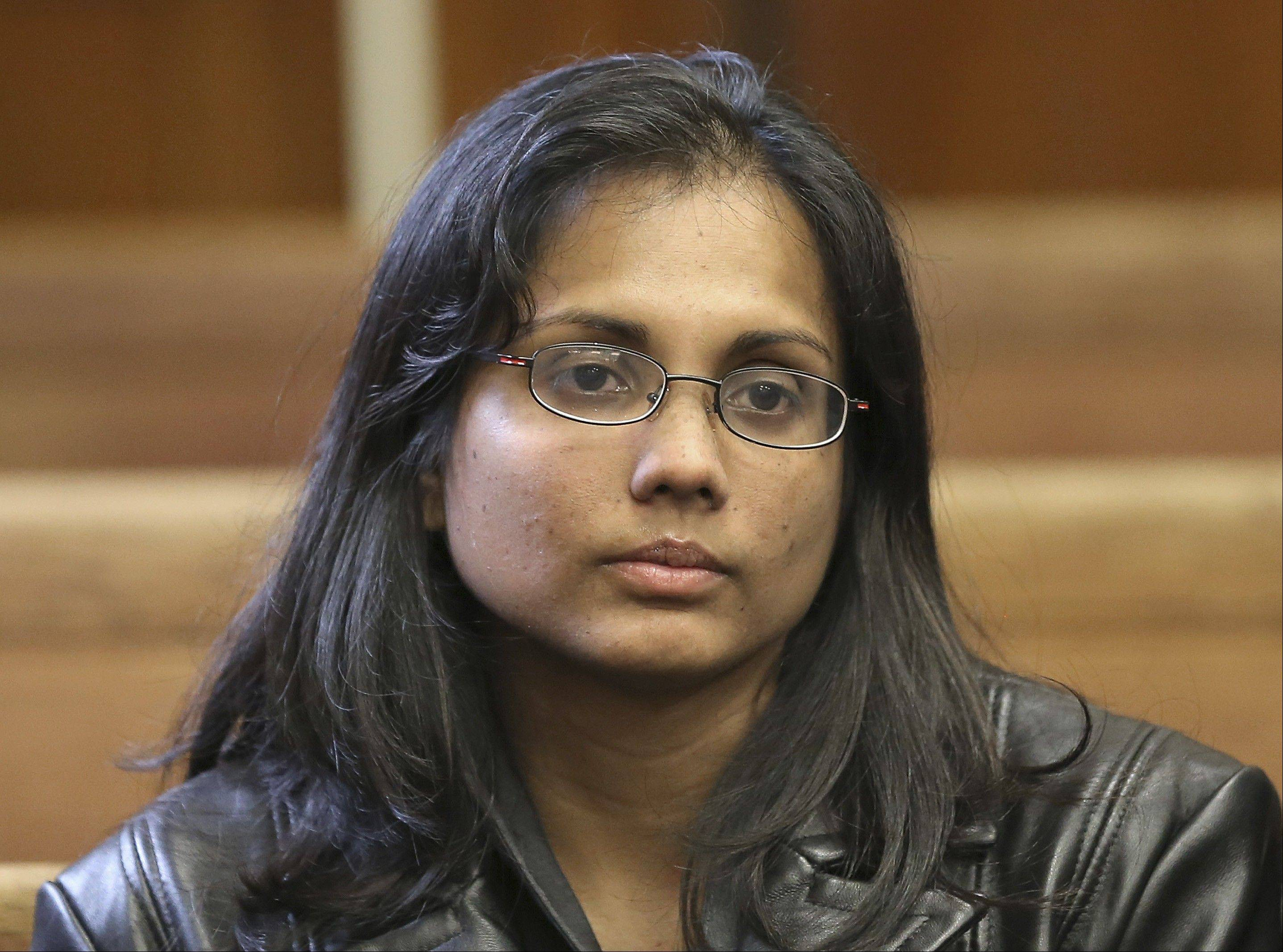 Former state chemist Annie Dookhan sits Friday in Suffolk Superior Court in Boston.