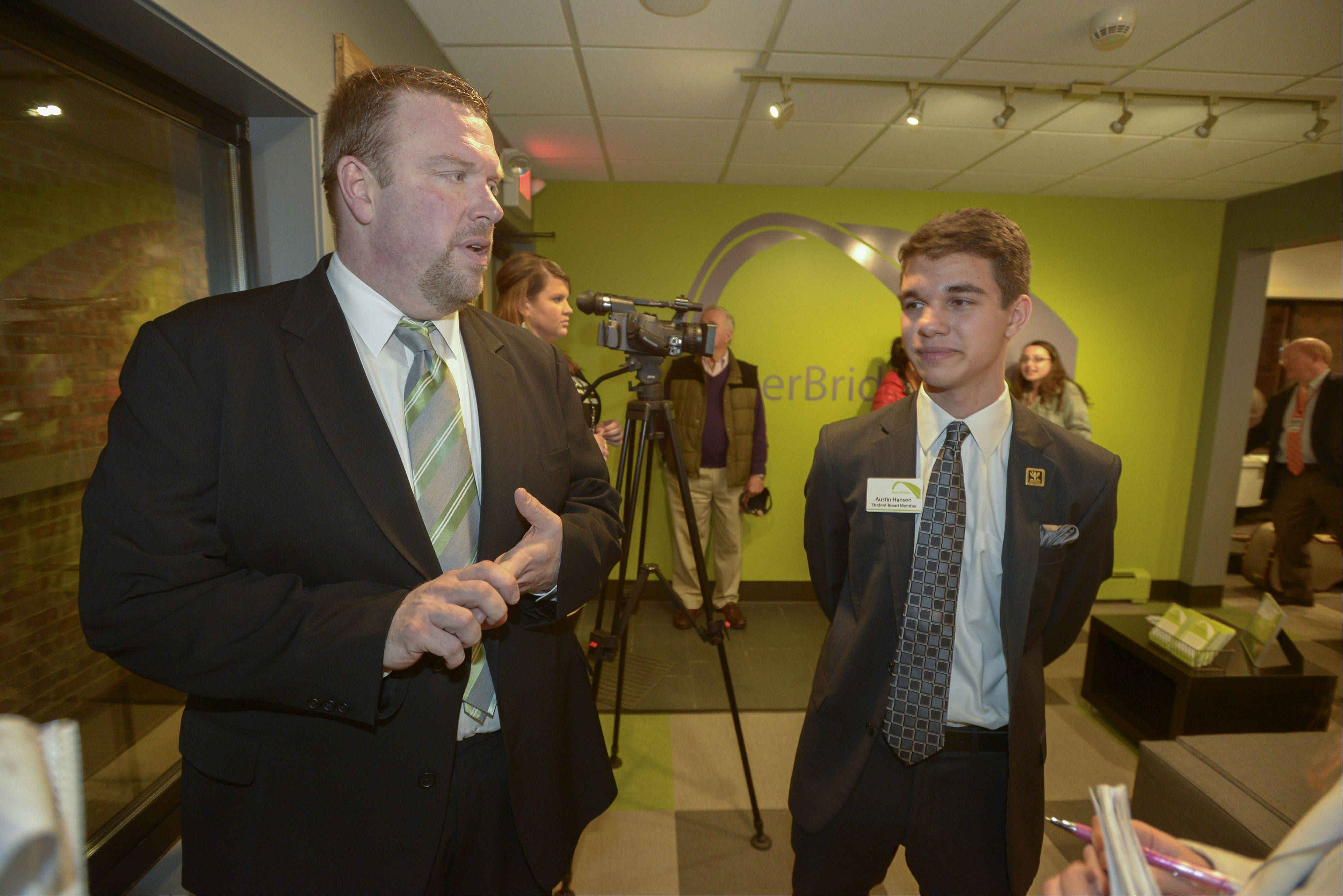 NaperBridge Executive Director Andy Jack and student board member Austin Hansen talk about the new teen center in downtown Naperville that will be unveiled Saturday during an open house.