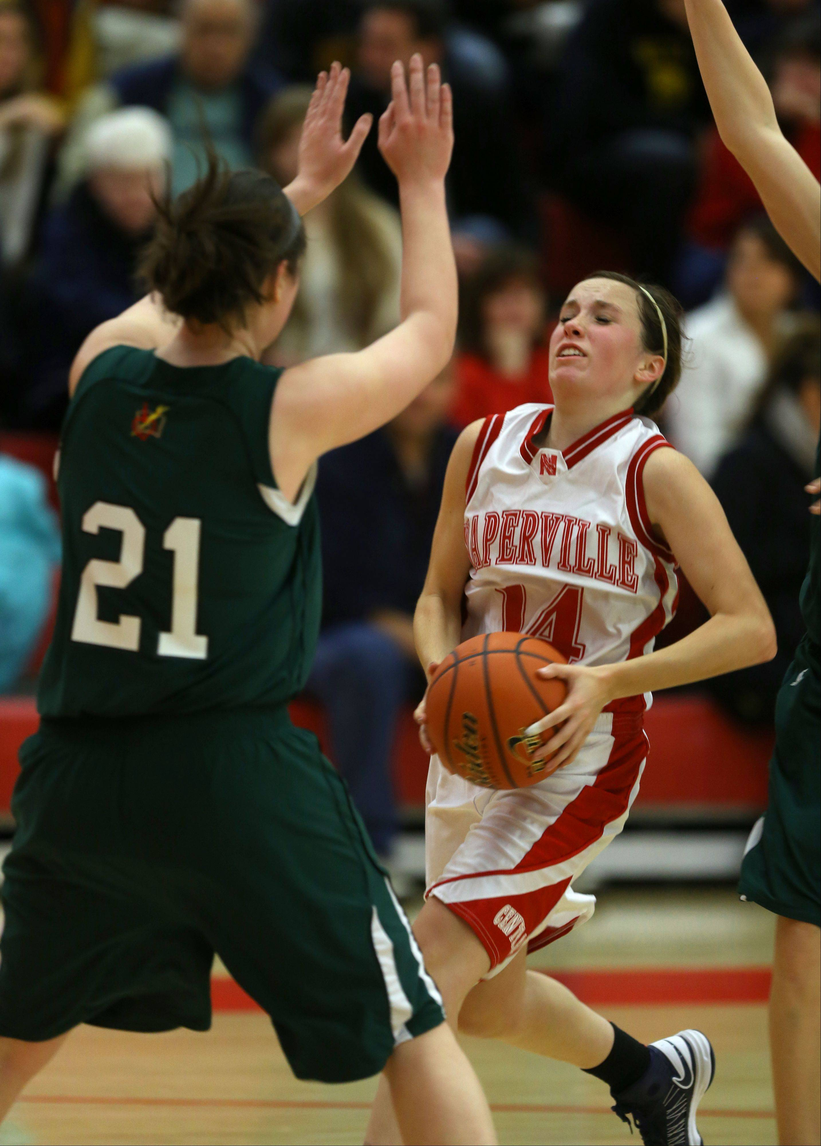 Naperville Central�s Emily Kraft drives the lane against Providence�s Mary Fashingbauer (21), during the 2013 girls basketball Tip-Off Tournament.