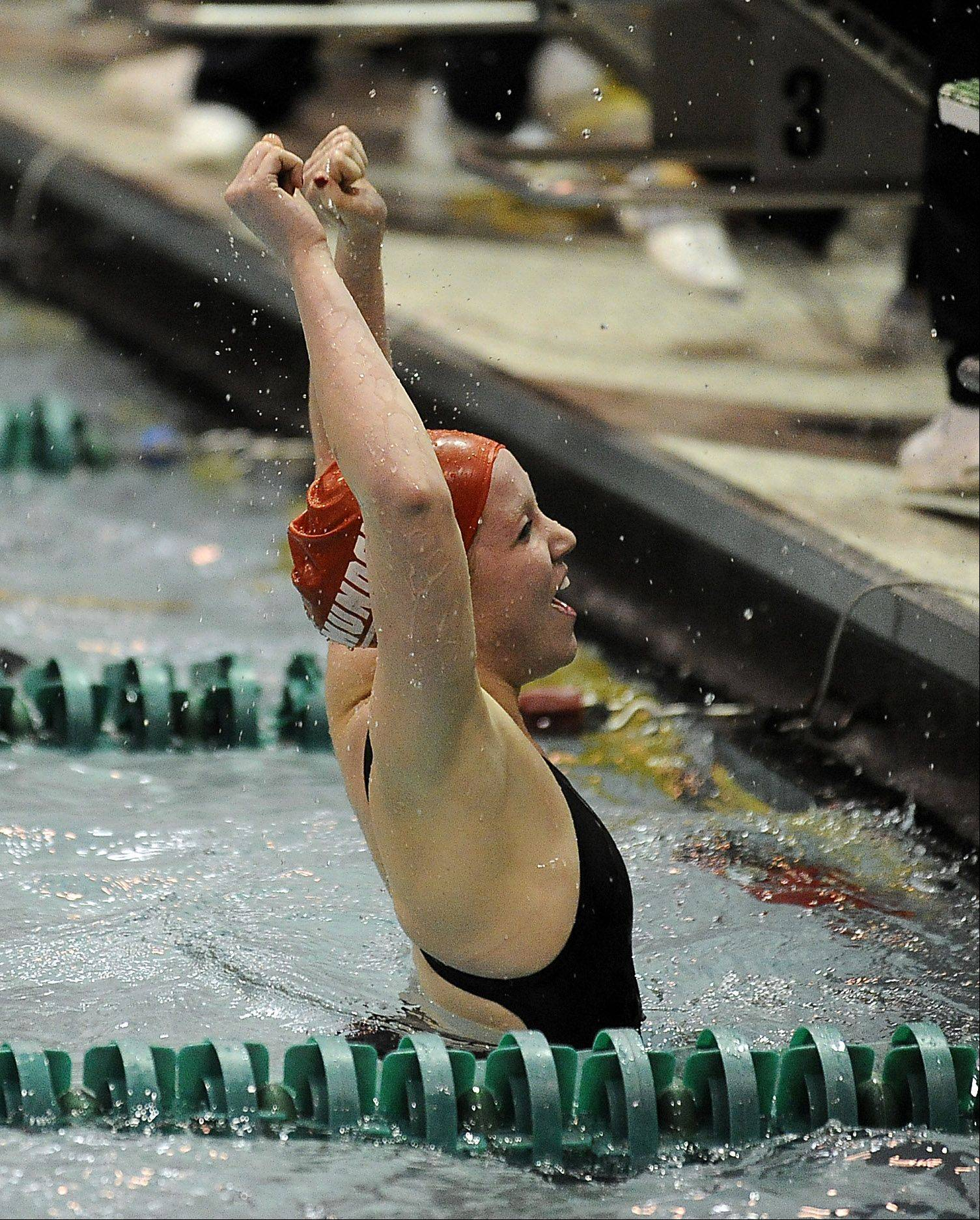 Mundelein's Erin Falconer celebrates her effort in 200-yard freestyle at the girls swimming state prelims at New Trier High School on Friday.