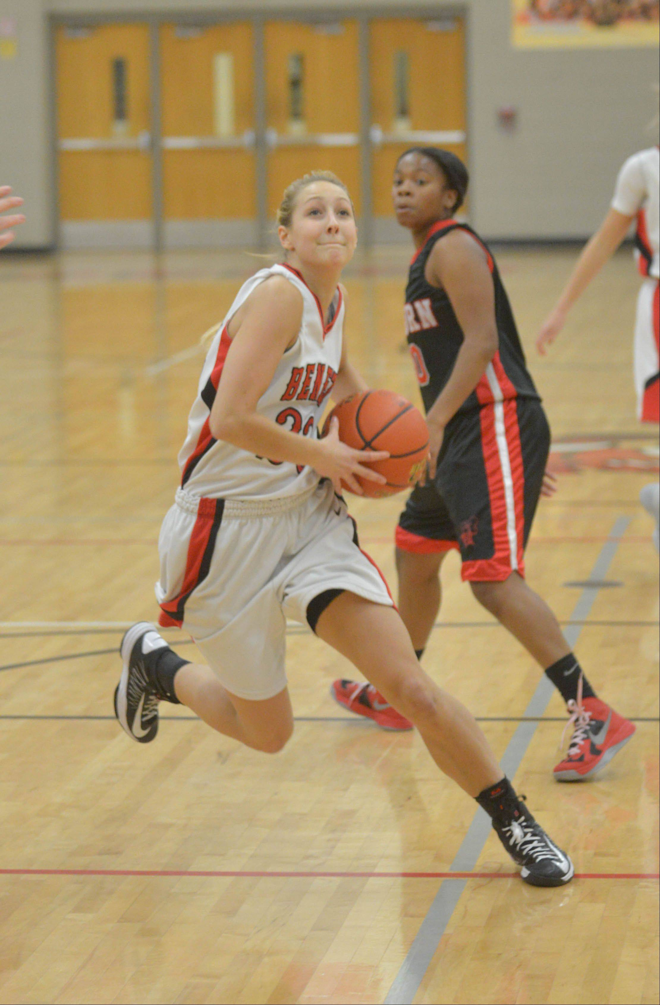 Emily Eshoo moves towards the net during the Rockford Auburn at Benet girls basketball game Friday.