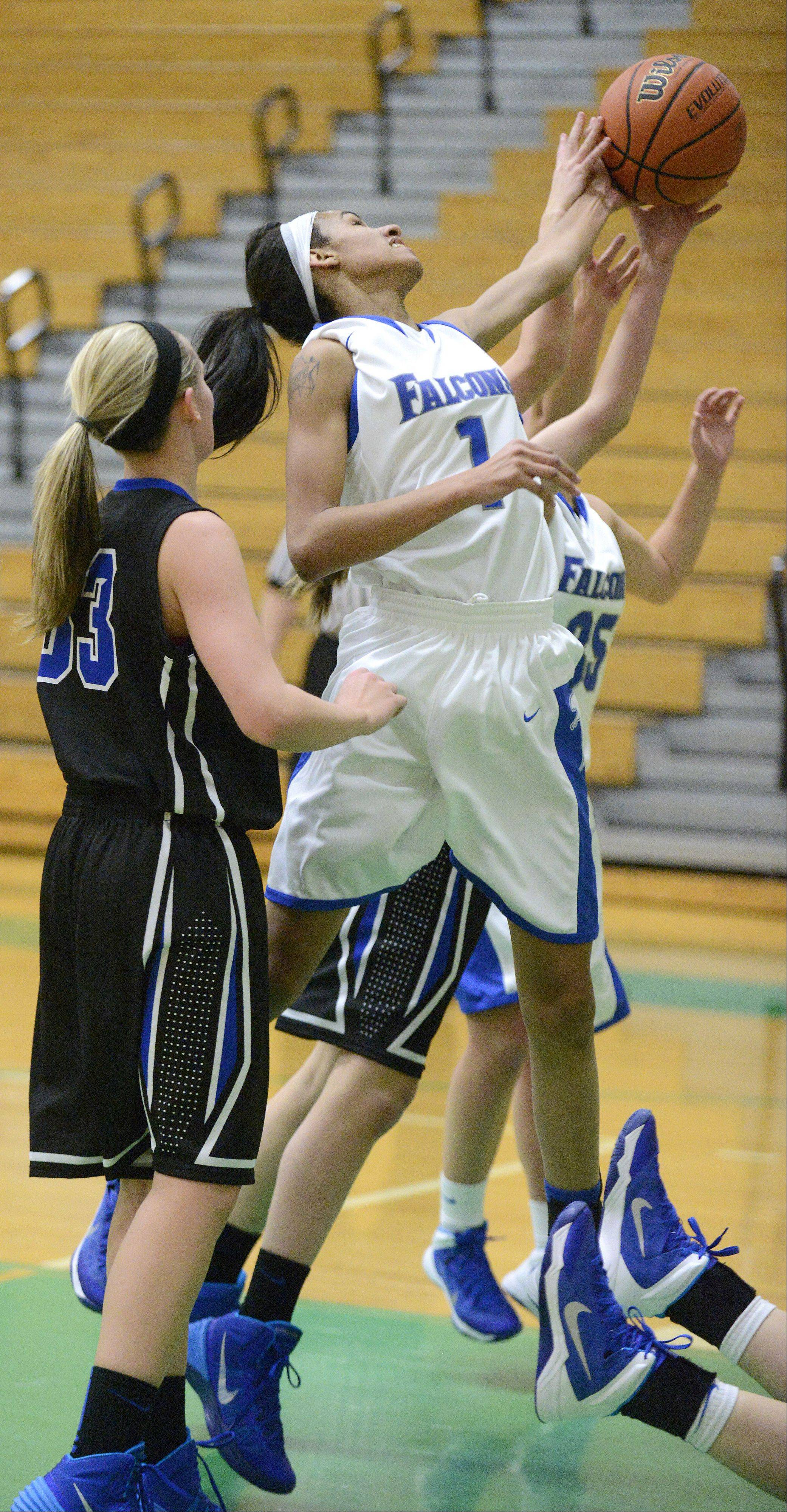 Wheaton North�s Emari Jones fights for a rebound in the first quarter on Friday, November 22.