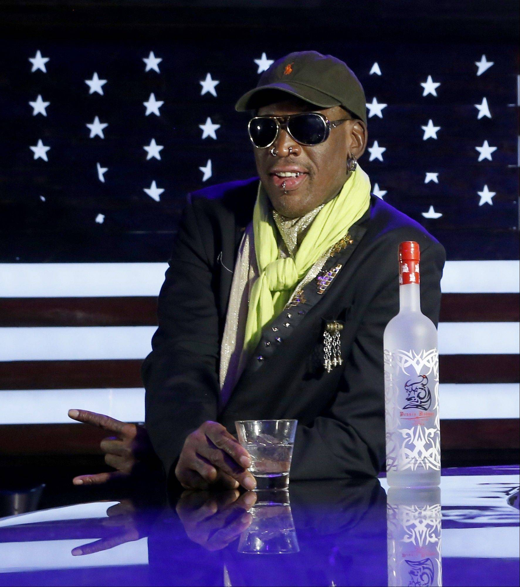 Dennis Rodman poses during a promotional event to pitch a vodka brand after a launch party Thursday in Chicago.