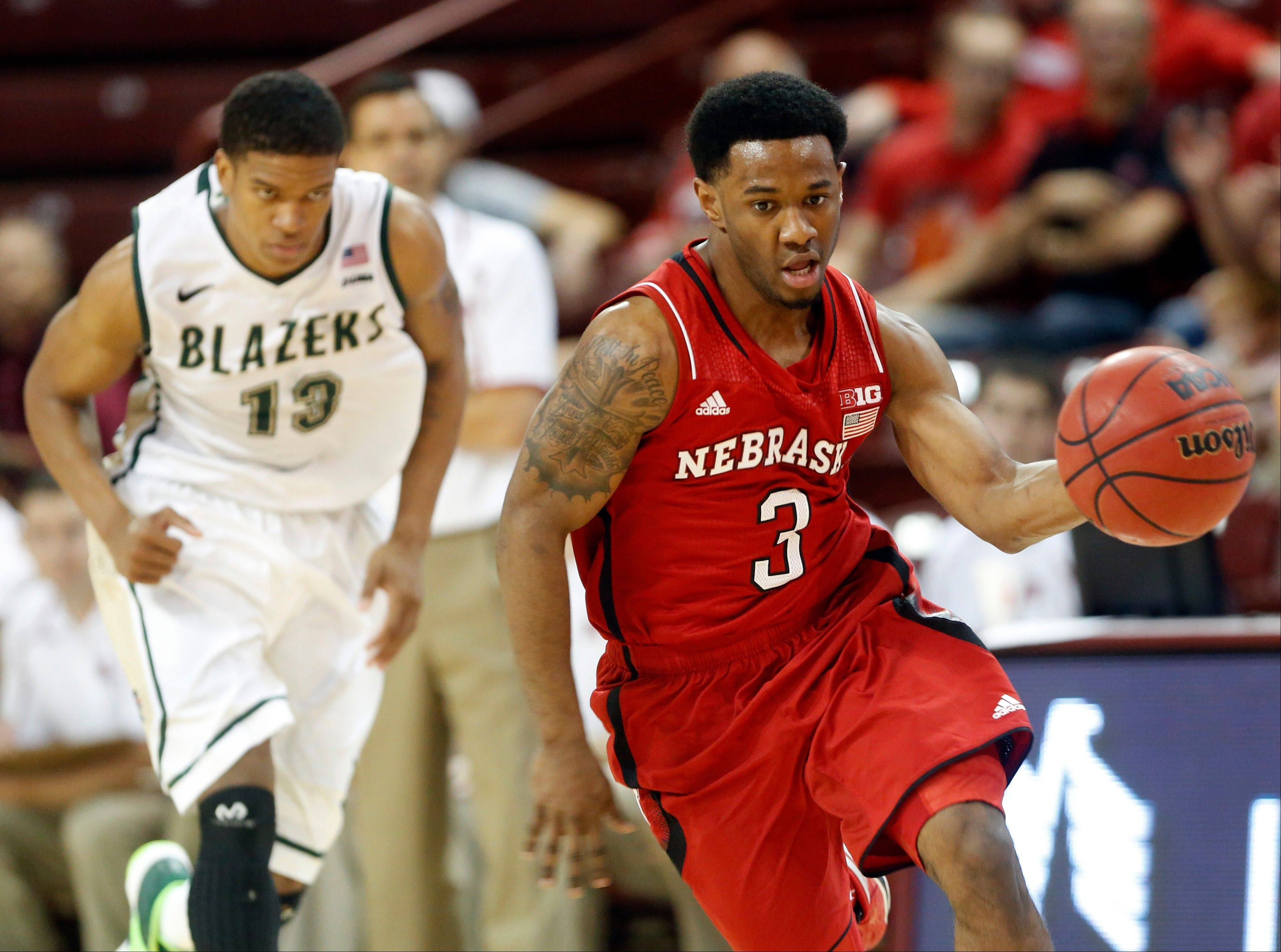 Nebraska's Benny Parker drives the ball up the court against UAB's Chad Frazier in the first half Friday at the Charleston Classic tournament in Charleston, S.C..
