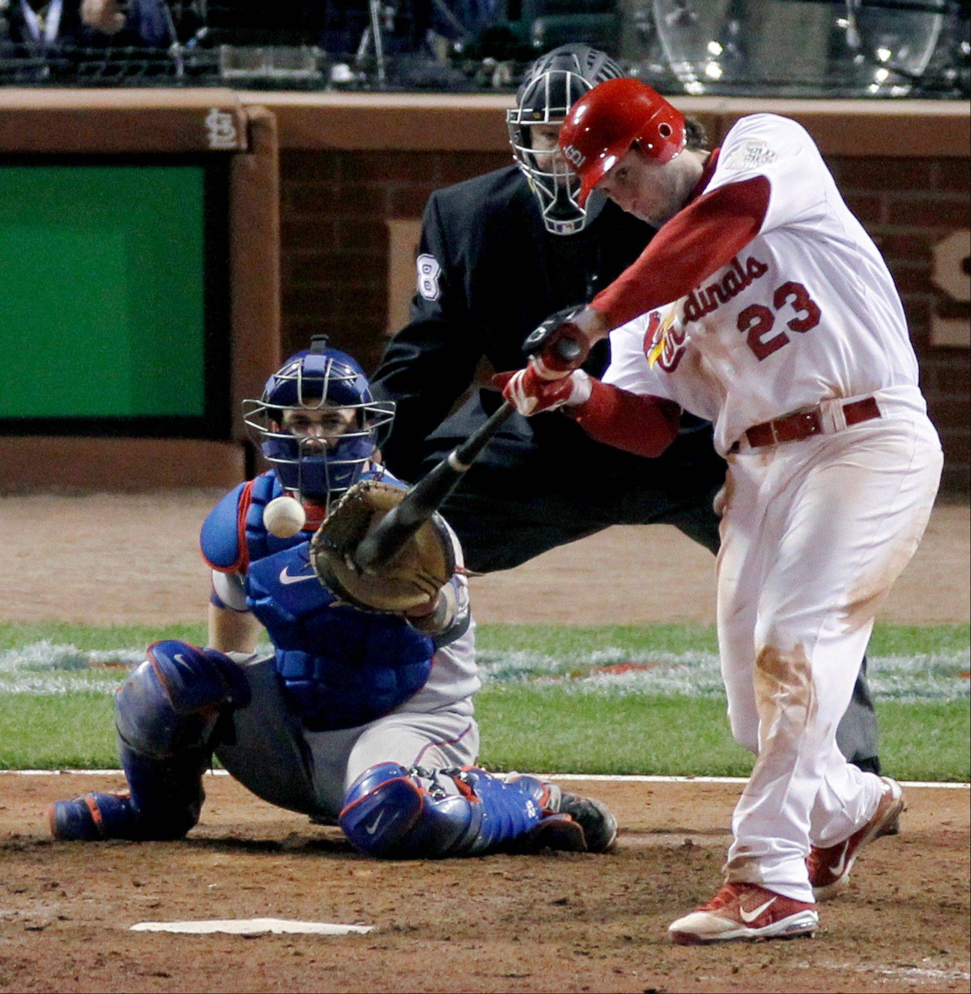 The Cardinals' David Freese hits a solo home run off Texas pitcher Mark Lowe in the 11th inning of Game 6 of the 2011 World Series.