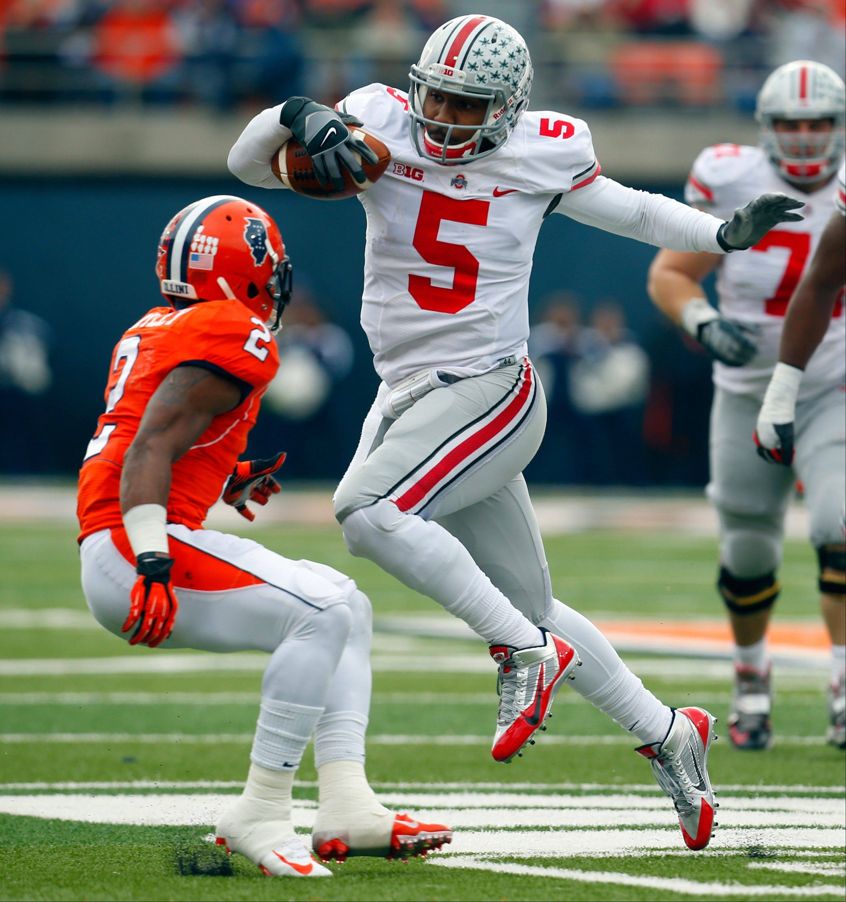Ohio State quarterback Braxton Miller tries to avoid Illinois defensive back V�Angelo Bentley during the first half of last Saturday�s game in Champaign, Ill.