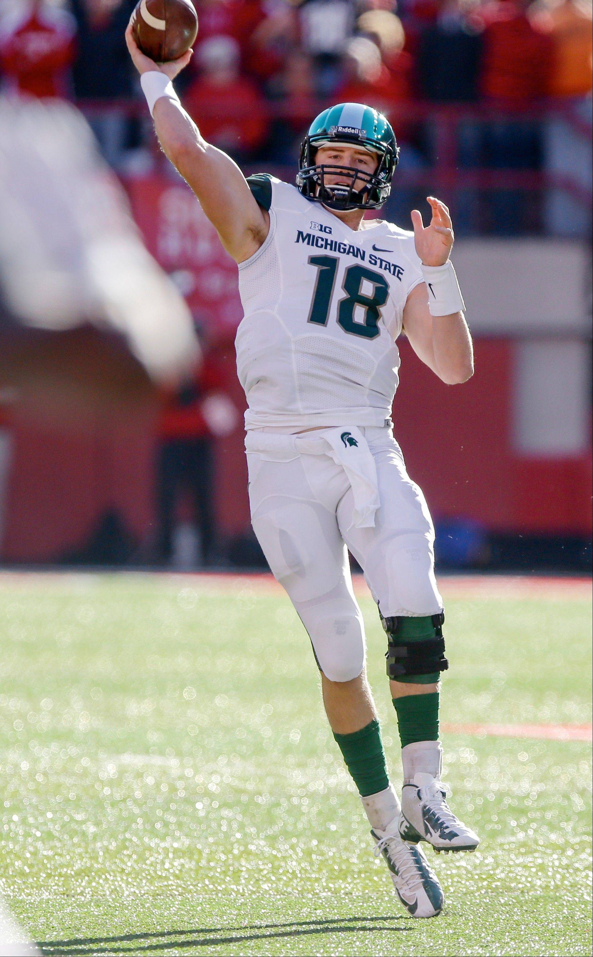Michigan State quarterback Connor Cook throws in the first half of last Saturday�s road win against Nebraska.