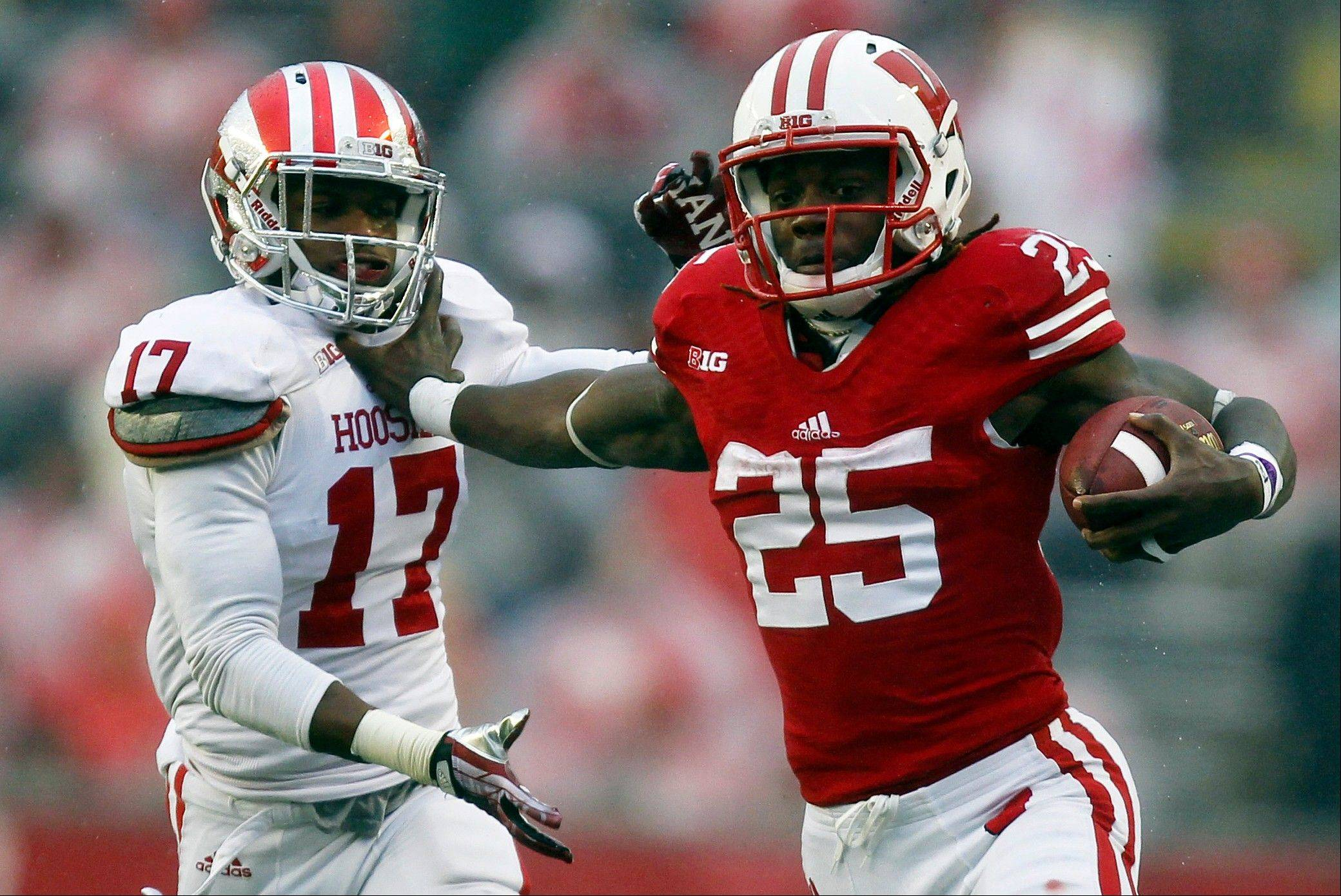 Wisconsin�s Melvin Gordon, right, pushes Indiana�s Michael Hunter away during the first half of last Saturday�s game in Madison.
