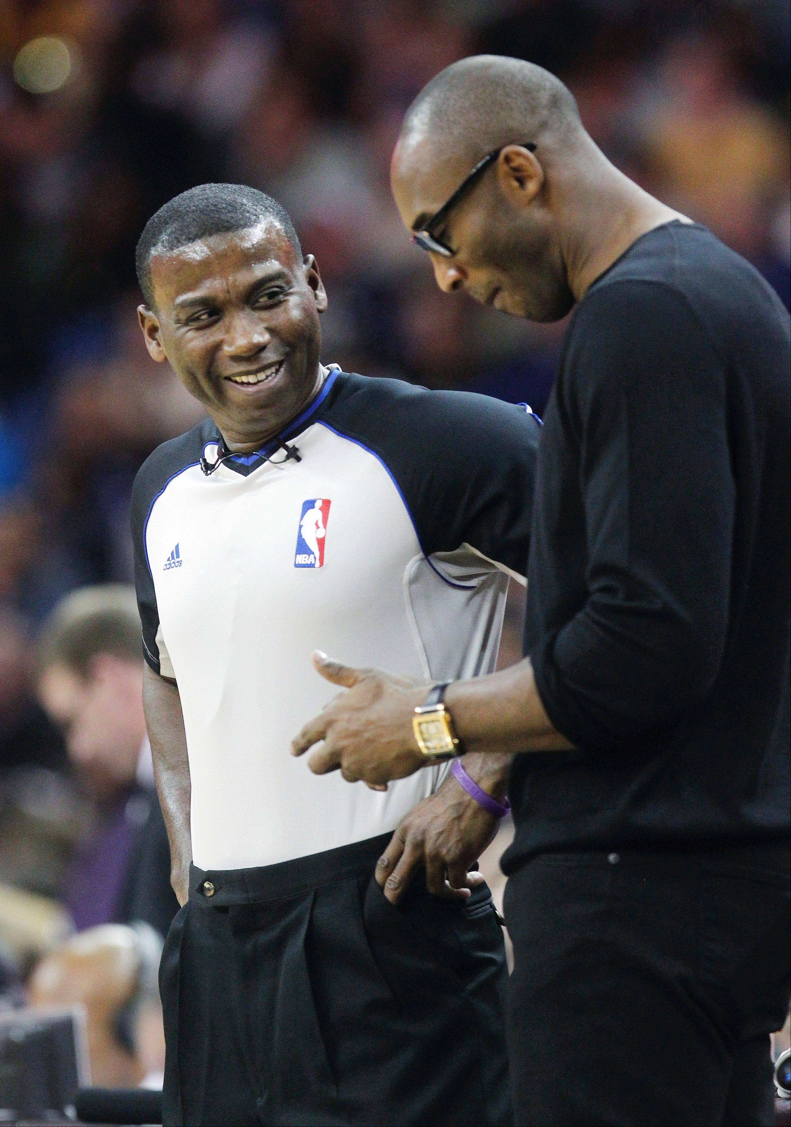 Los Angeles Lakers player Kobe Bryant, right, is hoping to return to action, possibly by the end of the month.
