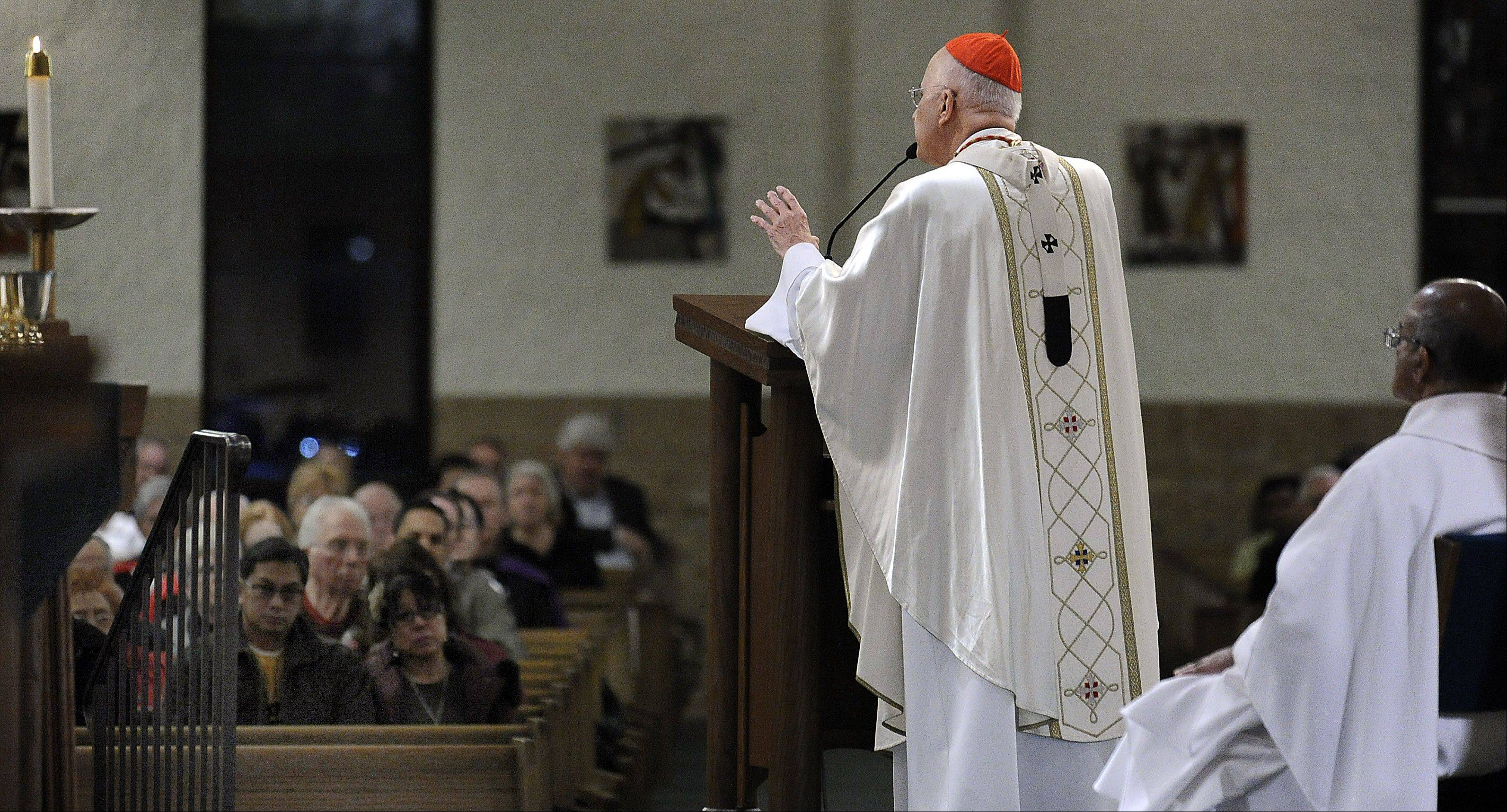 "Cardinal George speaks during Mass Saturday at St. Mary's Church in Buffalo Grove as part of ""Day of Catholic Education."""