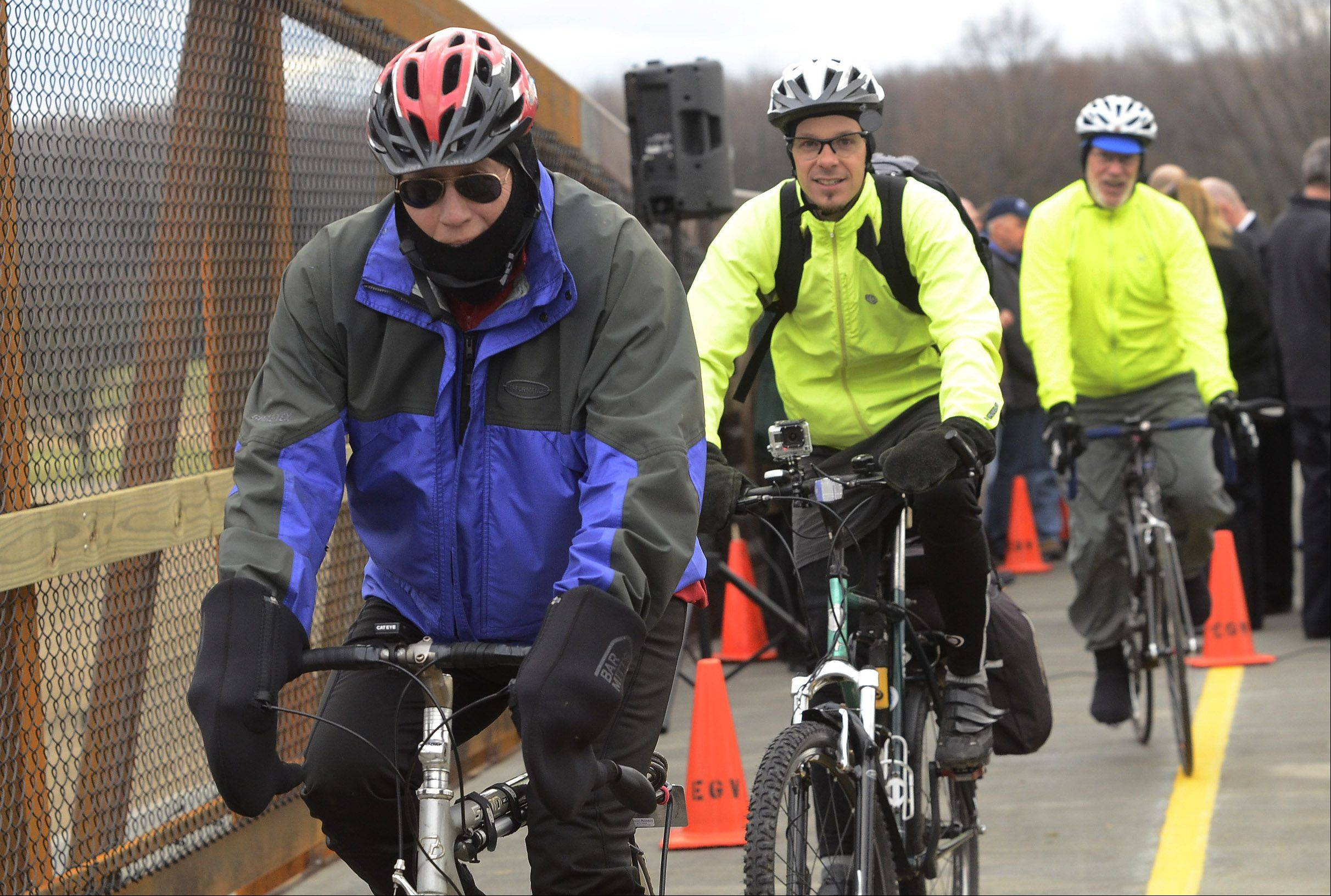 Bicyclists make their way across a new $2.7 million overpass after it was formally dedicated on Friday.