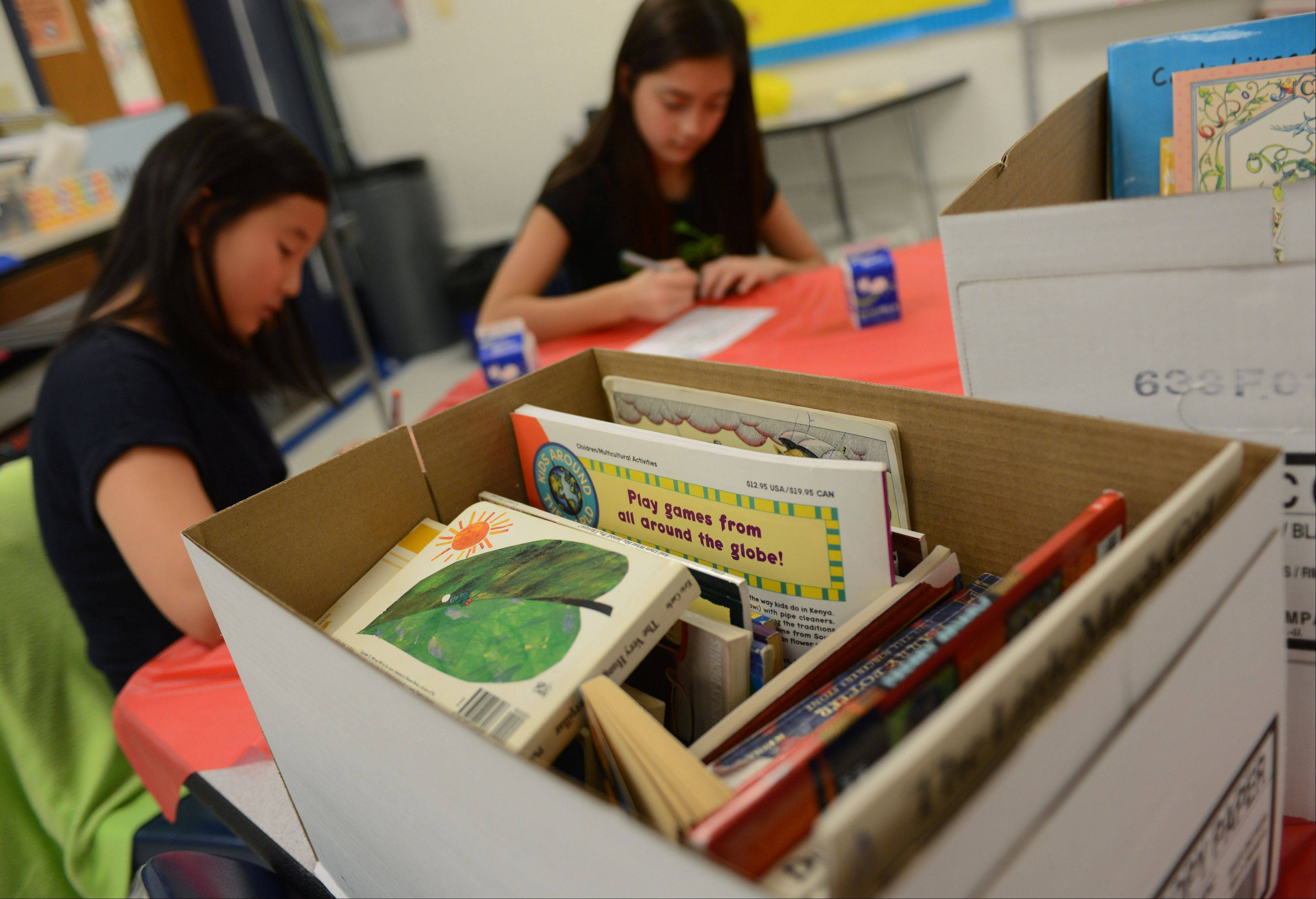 Hawthorn Middle School North sixth grade students in Rachel Serlin's Language Arts classes, including Ellie Kim, left, and Iviiy Salazar, collected around 500 books to donate to PADS Lake County. The collection was part of a nationwide literacy program called Milk + Bookies.