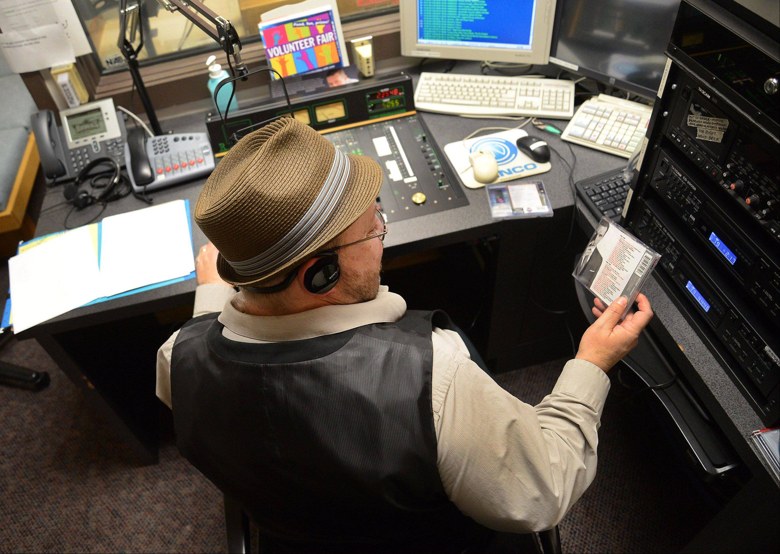 "Alan Leinonen, aka Mister Al, performing his Mister Al's Lounge radio program on Harper College's student radio station, picks out a selection from the soundtrack to the TV series ""Mad Men."""