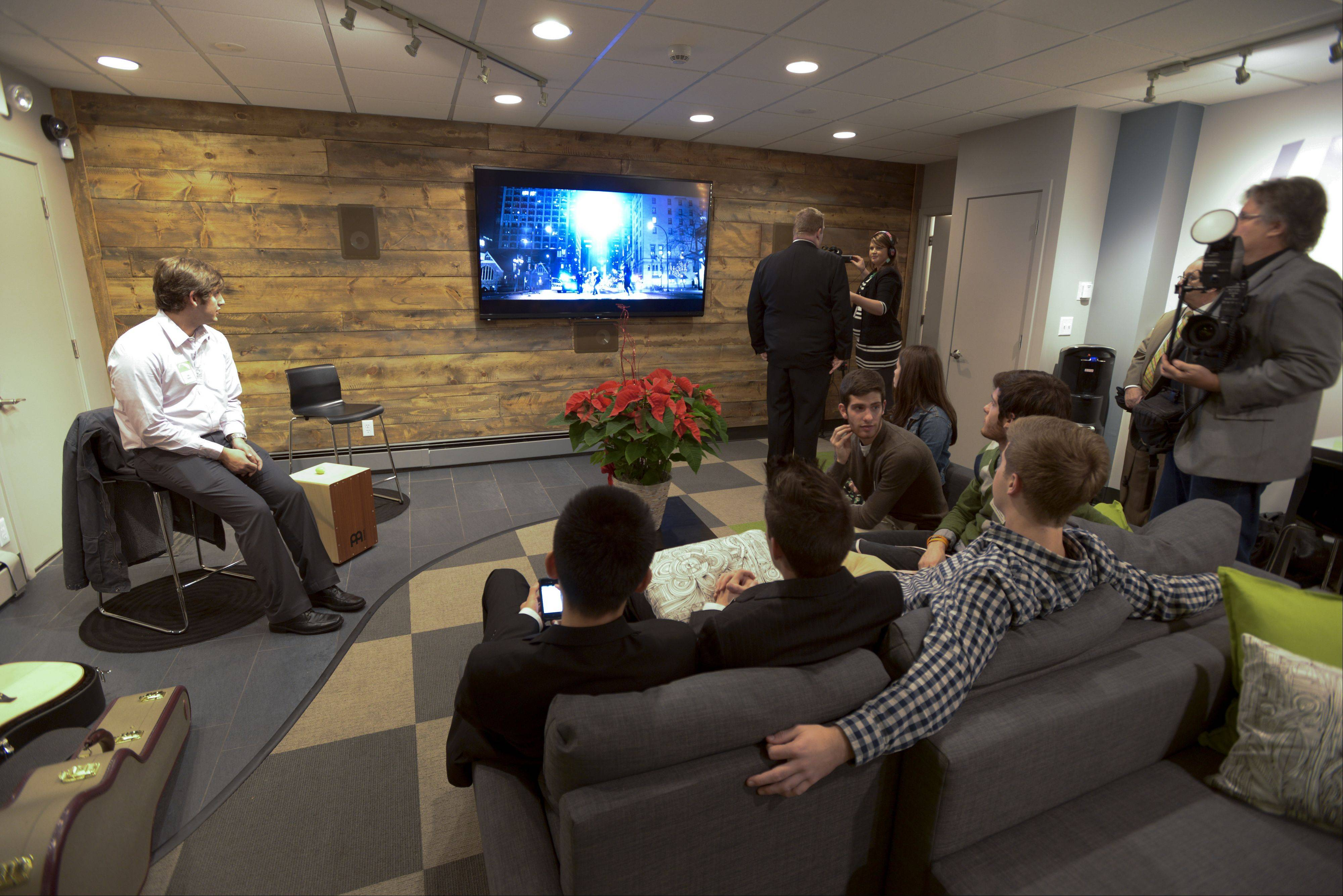 The new NaperBridge teen center in downtown Naperville includes amenities such as a huge flat screen TV, several seating areas and an area for local bands to preform.