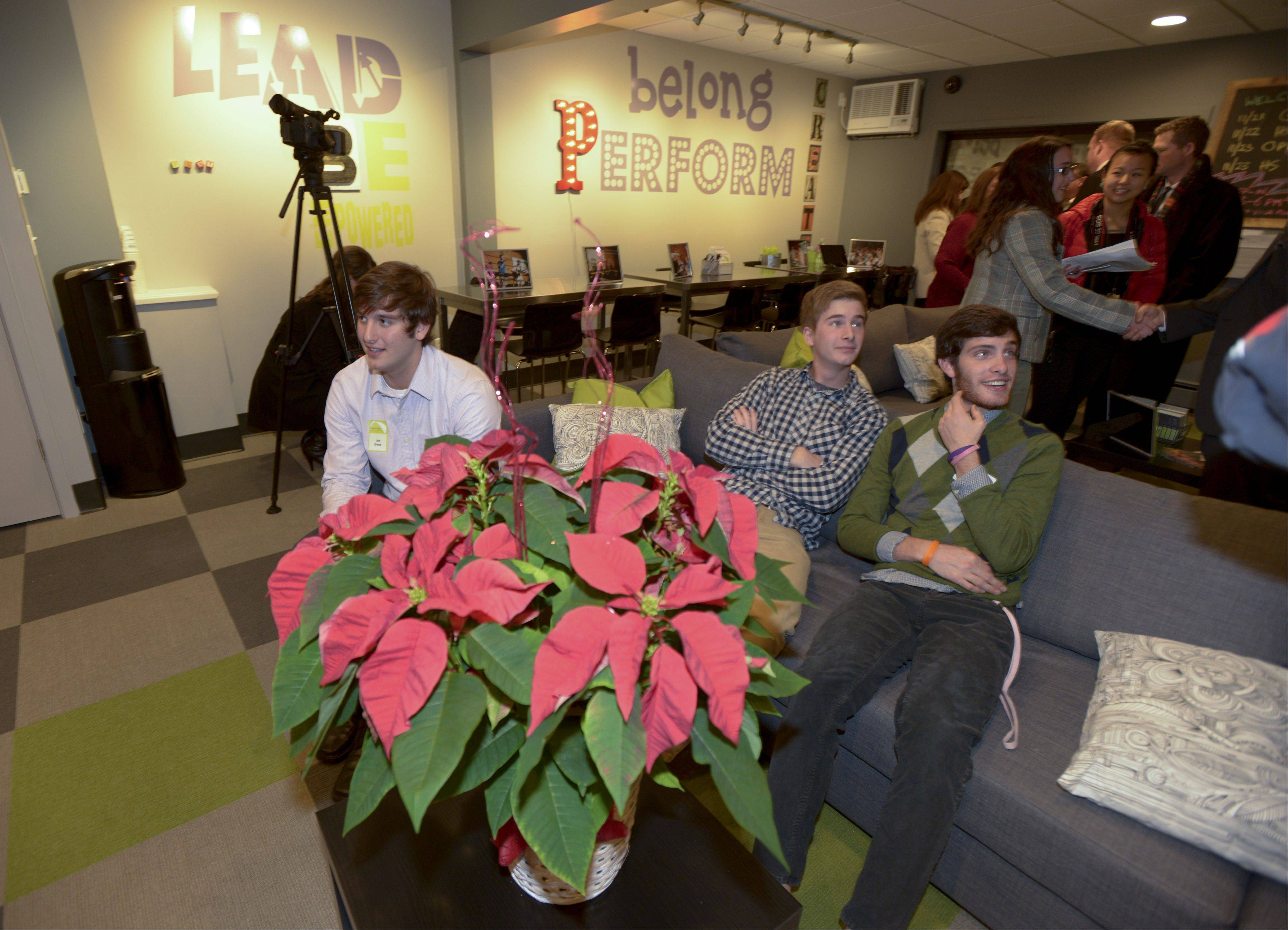 Joey Greco, Ethan Rader and Michael Drake try out the couches in the new NaperBridge teen center.