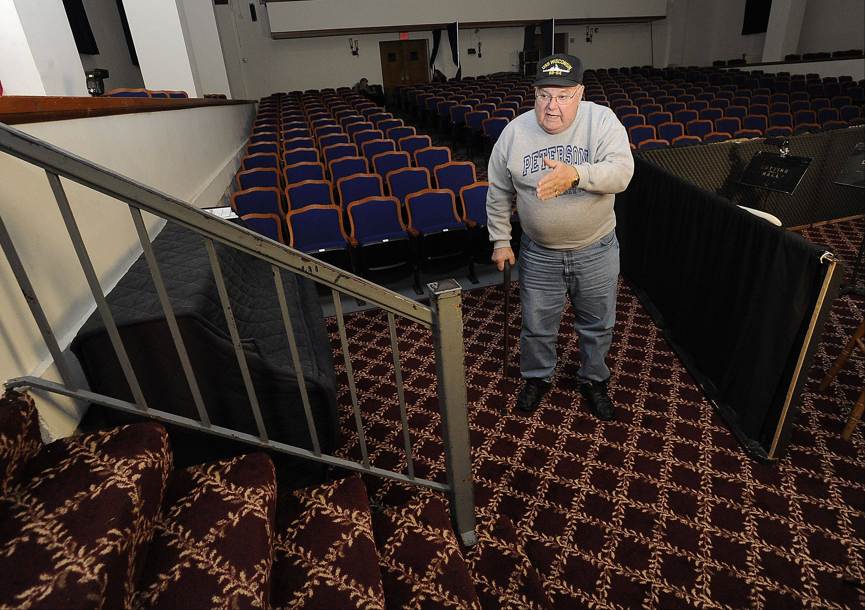 Former Palatine High School teacher Larry Peterson, of Lake Zurich, was monitoring a study hall on Nov. 22, 1963, when he heard President John F. Kennedy had been shot. Peterson is standing in the exact same spot in what is now Palatine's Cutting Hall where, 50 years earlier, he was told the news by a student standing on the bottom step.