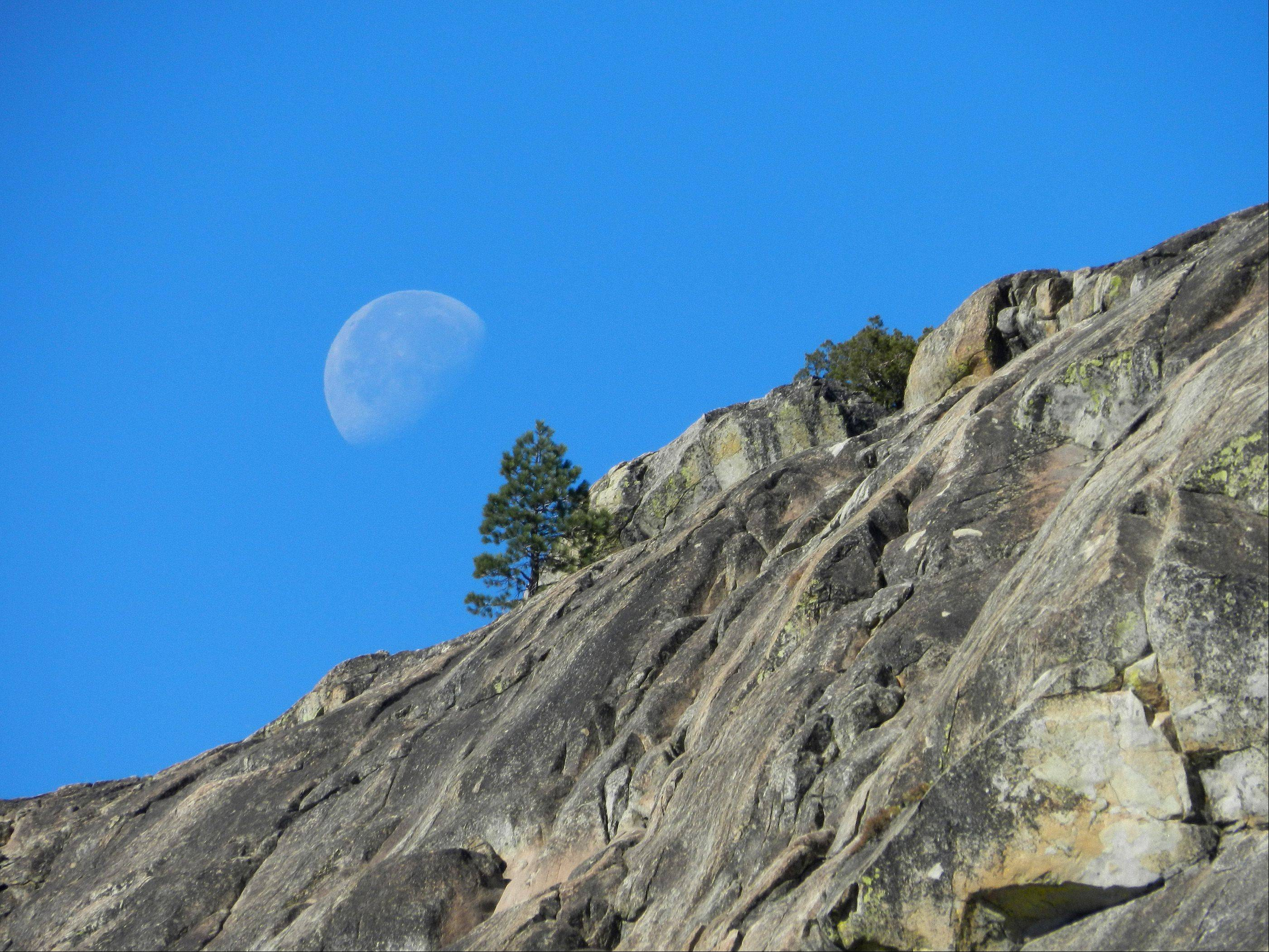 This is the moon looking over the mountain side at Donner Pass, which crosses the Sierra Nevadas just north of Lake Tahoe.