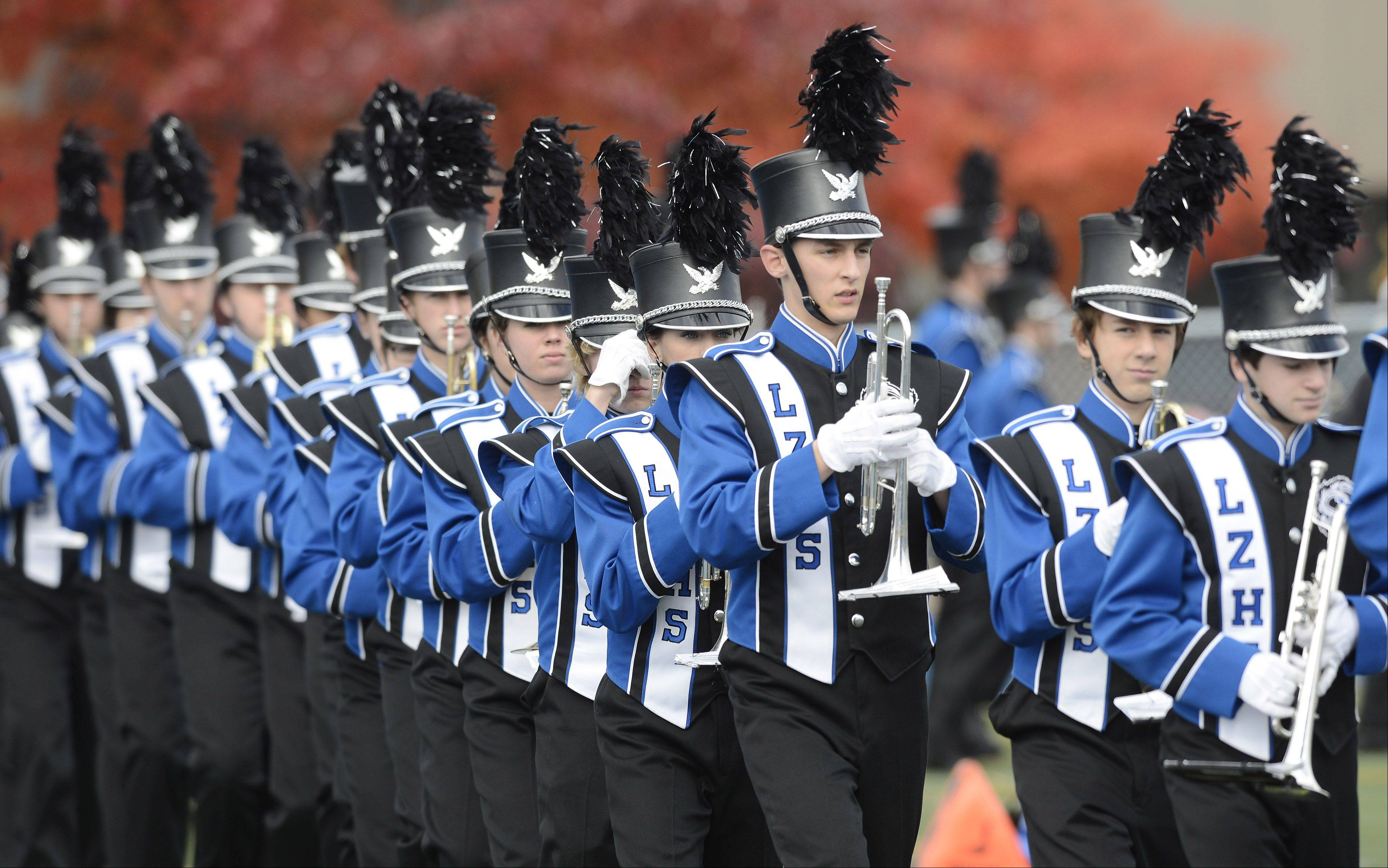 The Lake Zurich High School band, which normally doesn't march in parades, will take part in two major marches -- one in Chicago and another in Spain.