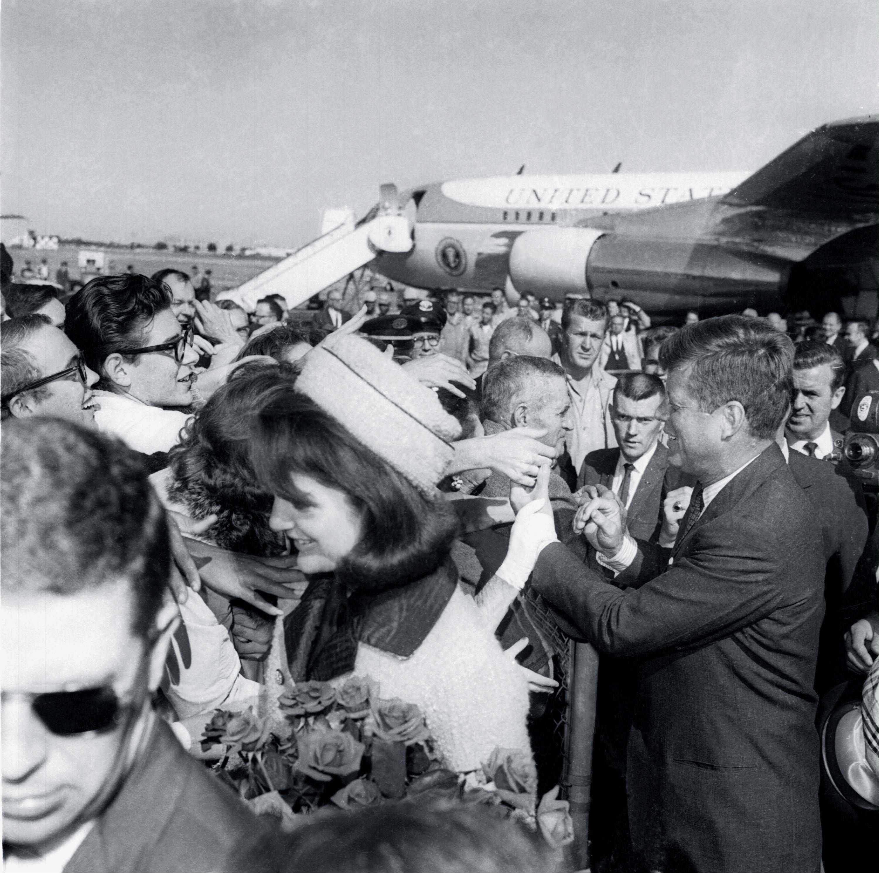 President Kennedy and the first lady Jacqueline Kennedy receive an enthusiastic welcome as they arrive in Dallas Love Field, Nov. 22, 1963. Later that day the president was assassinated as his motorcade moved through the city.