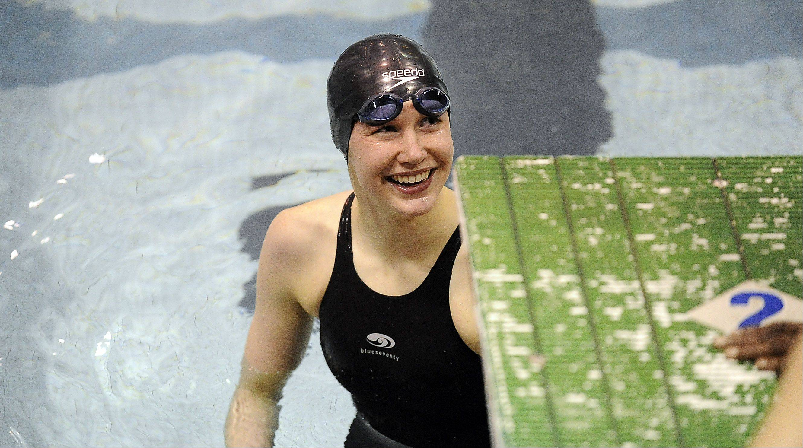 Erica King is all smiles after the 500-yard freestyle in the girls swimming state prelims at New Trier High School on Friday.