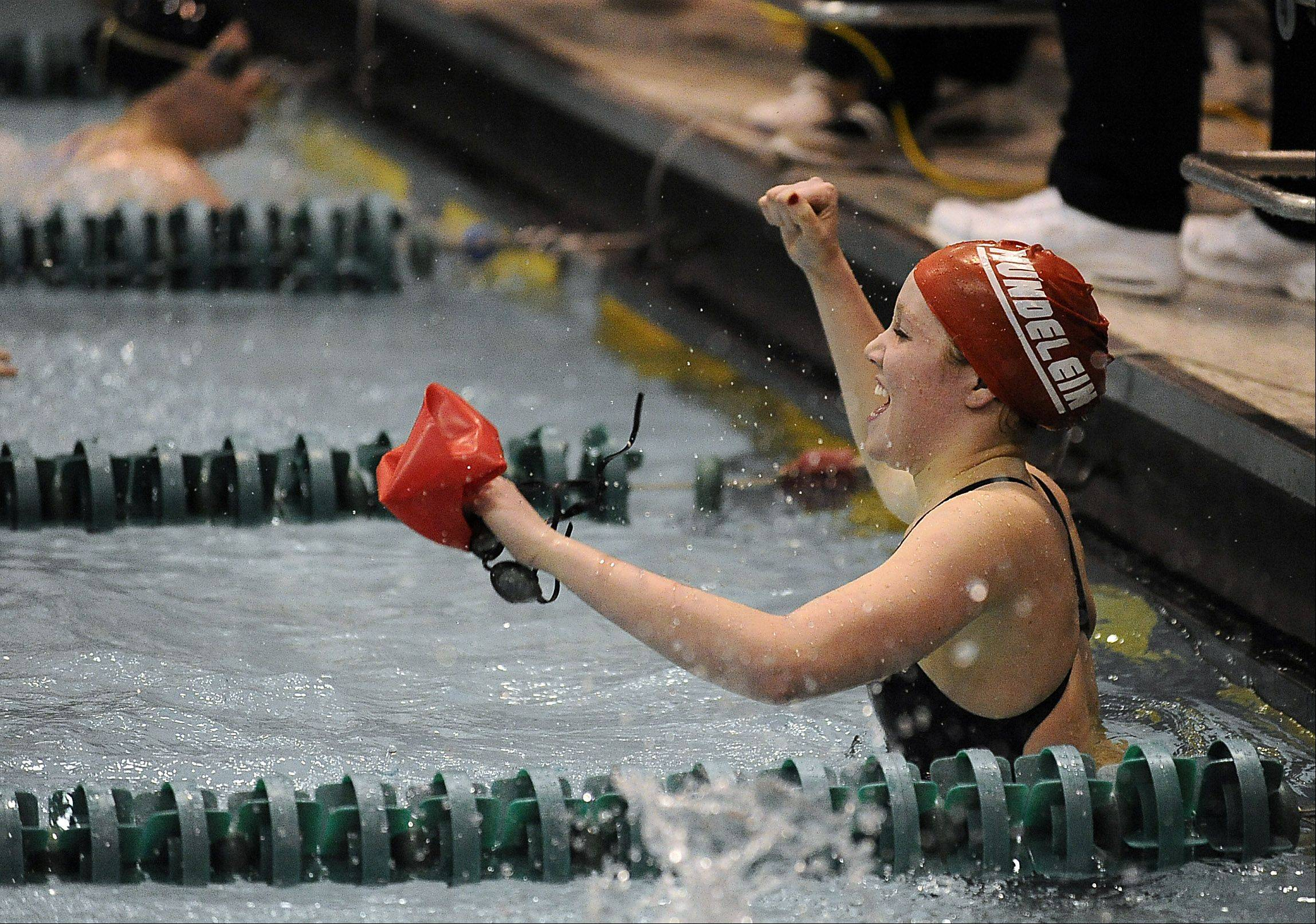 Mundelein's Erin Falconer celebrates after the 200-yardd freestyle in the girls swimming state meet prelims at New Trier High School on Friday.